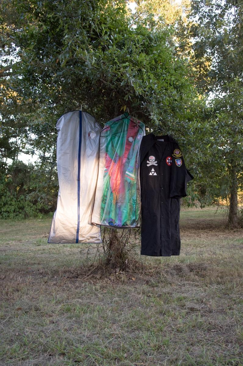 Louisiana. 2007. Klan robes hang from a tree at Klan rally hosted by the Bayou Knights of the Ku Klux Klan.