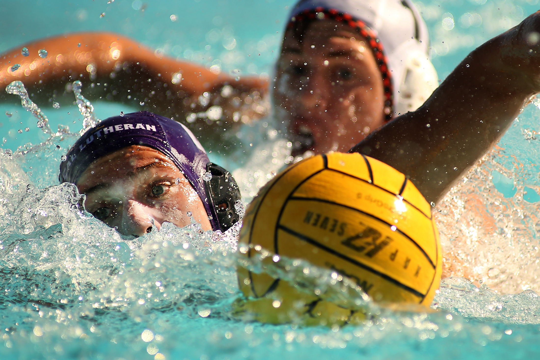 Cal Lutheran's Seth Hightower #8 fights to keep the ball away from Occidental College's Alex Marriott #11 during a water polo match at Cal Lutheran on Nov. 3, 2018.  ©2018 Katharine Lotze