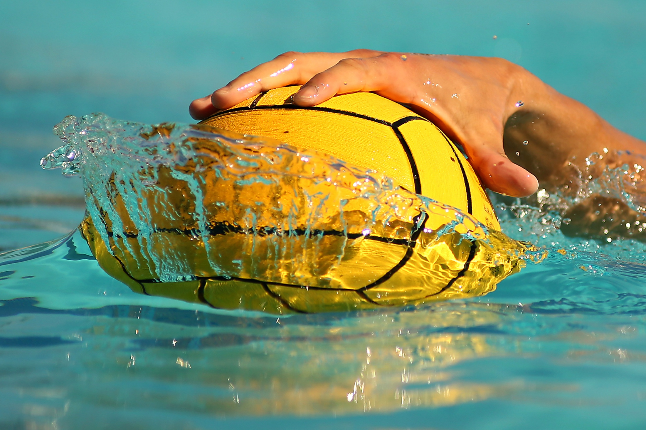 A water polo player stops the ball during a match between Cal Lutheran and Occidental College on Nov. 3, 2018.  ©2018 Katharine Lotze