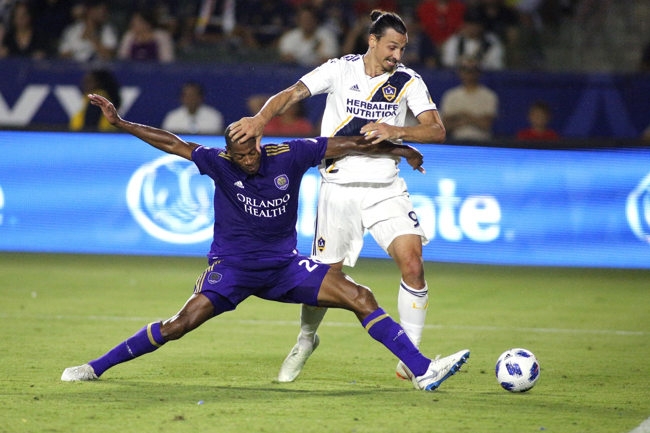 Zlatan Ibrahimovic #9 of the Los Angeles Galaxy and Chris Schuler #28 of the Orlando City SC fight for control of the ball at StubHub Center on July 29, 2018 in Carson, California. Katharine Lotze/Getty Images