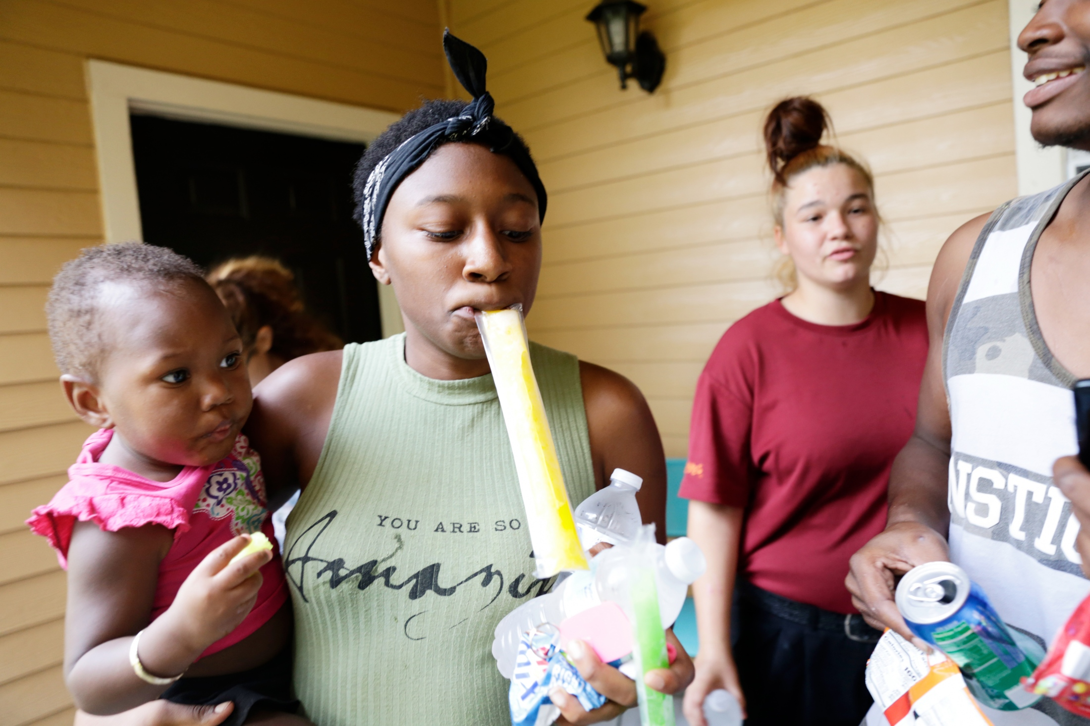 From left: Kayone Braxton, Conslyn Braxton, Jasmine Fields and Andrew Martin load up on the free snacks available while touring a model unit at The Commons, a student housing complex in Tallahassee, Fla., on Aug. 23, 2018 All are currently without a fixed address. Nightly shelter is provided by friends and co-workers, at least temporarily. Not knowing where their next meal will come from any free food and drink is taken advantage of. Fields is hoping to move into The Commons with help from her Capital City Youth Services caseworker.