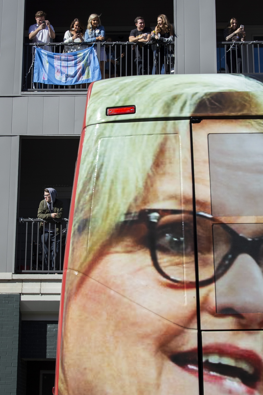 U.S. Senate candidate Josh Hawley's campaign bus drives by spectators at the University of Missouri homecoming parade downtown Columbia, Mo. on Saturday, Oct. 20, 2018. Hawley's bus displayed the face of his opponent U.S. Sen. Claire McCaskill, D-Mo.