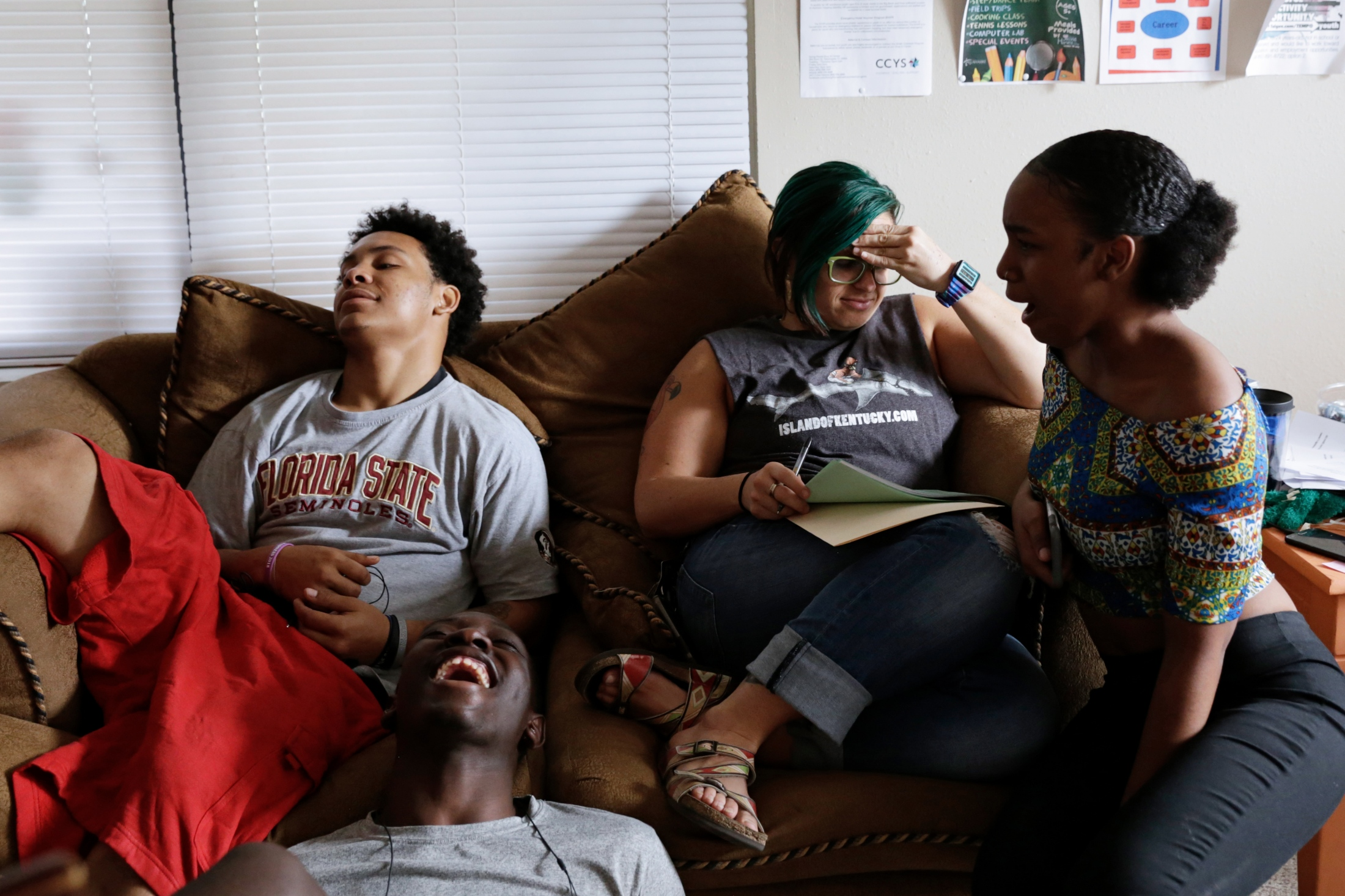 Mike McLaughlin, Ladarius Simmons, caseworker Erin Foley and Samiah Williams react to Ladarius's latest joke at the drop-in center Going Places. Going Places takes an informal approach enabling caseworkers to establish trust with the youth who visit.