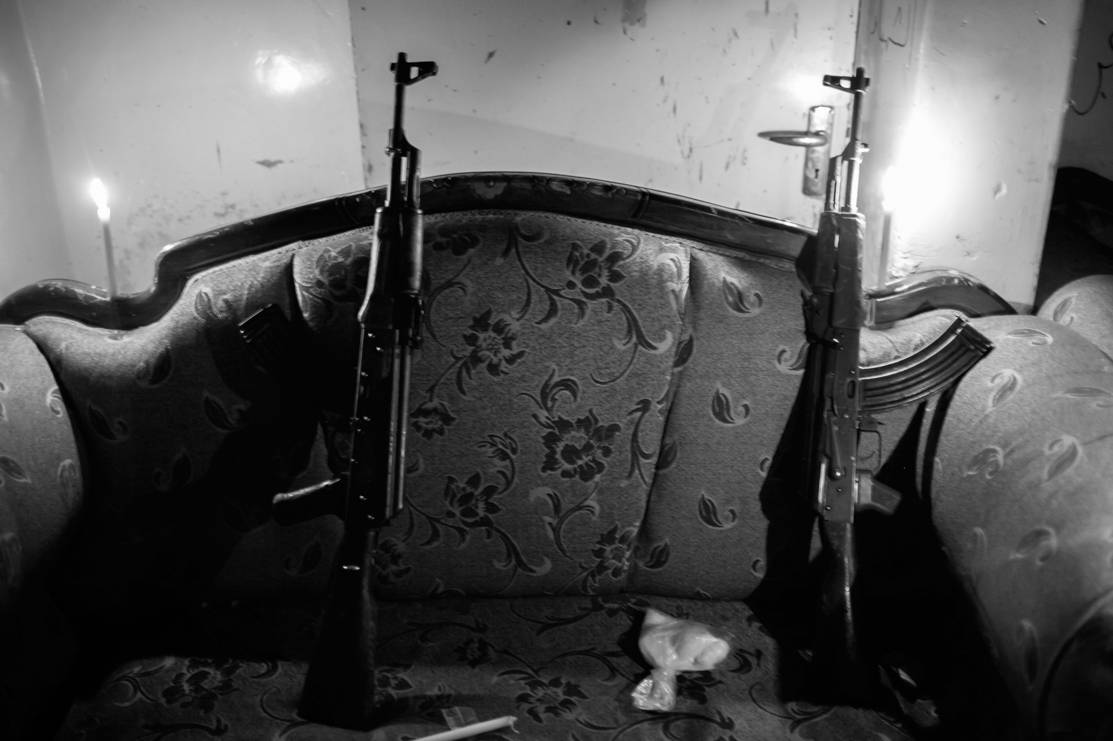 """Two AK47 inside a building used by Islamist Rebel forces to relax in the frontline of Izaah neighborhood of Aleppo, Syria, Wednesday, Jan. 3, 2013. The United Nations estimated that more than 400,000 people have been killed in Syria's 60-month-old uprising against authoritarian rule, a toll one-third higher than what anti-regime activists had counted. The U.N. human rights chief called the toll """"truly shocking."""" Copyright: Spanish Photojournalist Andoni Lubaki"""
