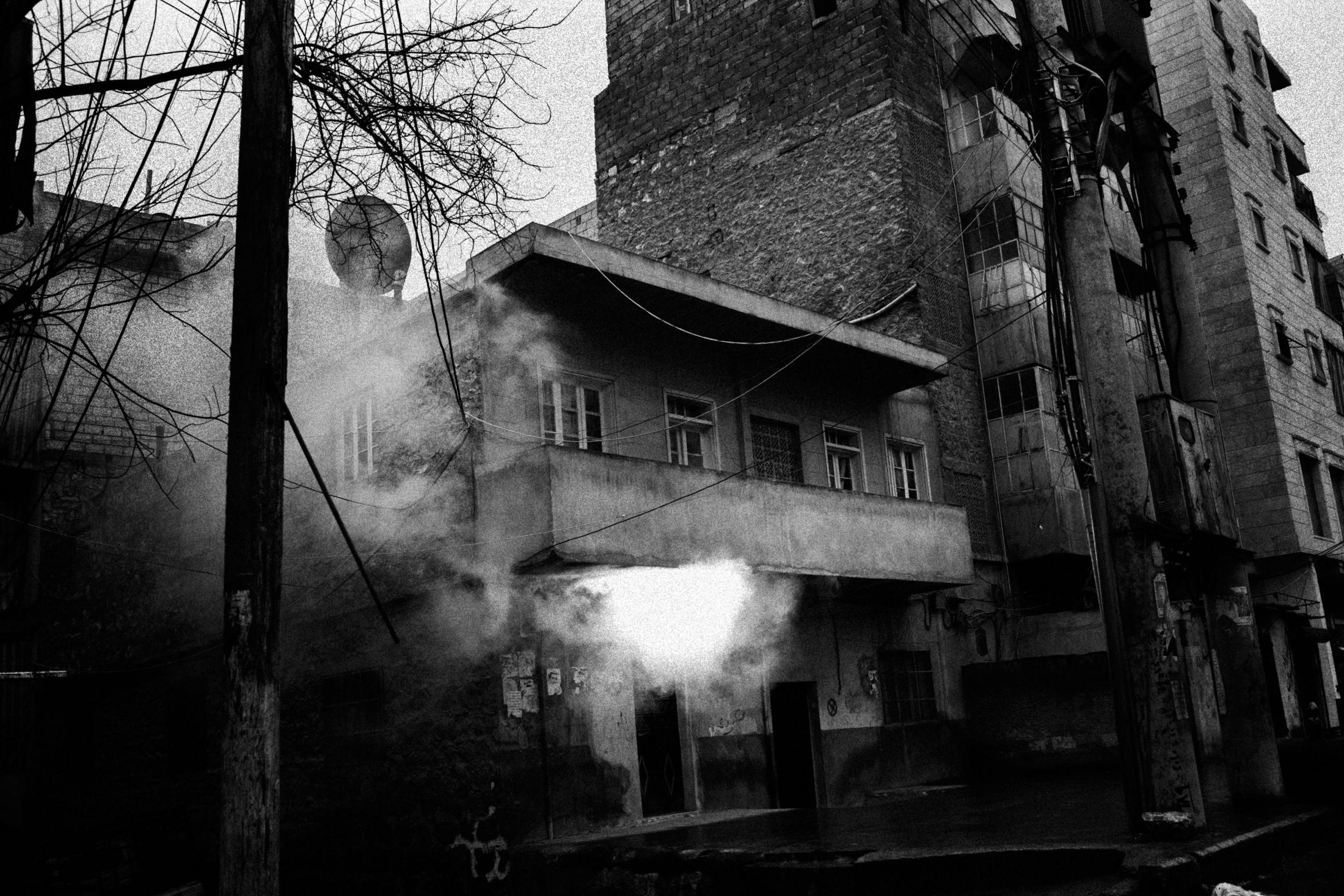 """A fire started after a bullet impact in a house plenty of gas tanks to cook in the neighborhood of Izaah of Aleppo, Syria, Wednesday, Jan. 5, 2013. The United Nations estimated that more than 400,000 people have been killed in Syria's 60-month-old uprising against authoritarian rule, a toll one-third higher than what anti-regime activists had counted. The U.N. human rights chief called the toll """"truly shocking."""" Copyright: Spanish Photojournalist Andoni Lubaki"""