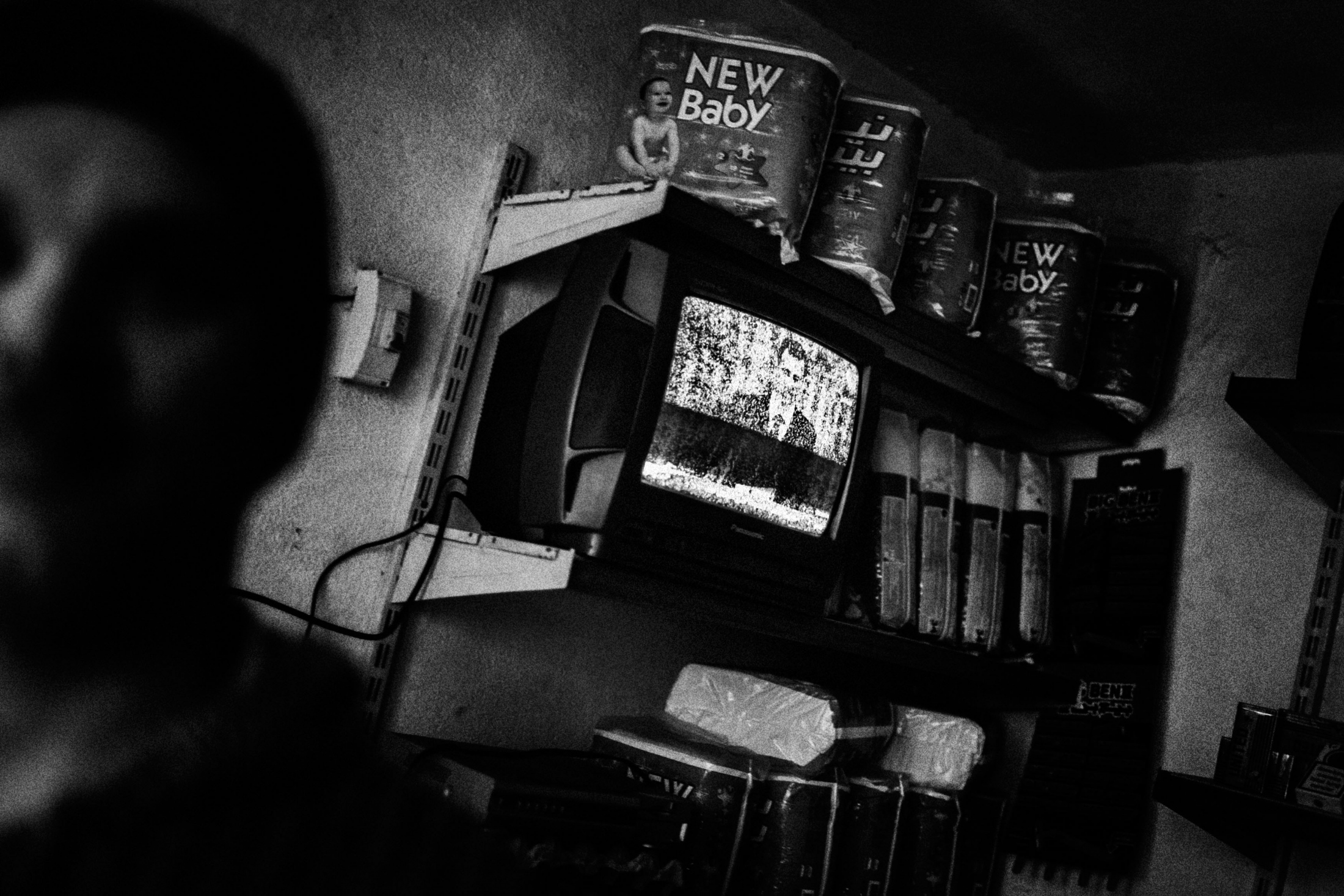 """A TV with the speech of Assad president in a shop in the Old City of Aleppo, Syria, Wednesday, Jan. 6, 2013. The United Nations estimated that more than 400,000 people have been killed in Syria's 60-month-old uprising against authoritarian rule, a toll one-third higher than what anti-regime activists had counted. The U.N. human rights chief called the toll """"truly shocking."""" Copyright: Spanish Photojournalist Andoni Lubaki"""