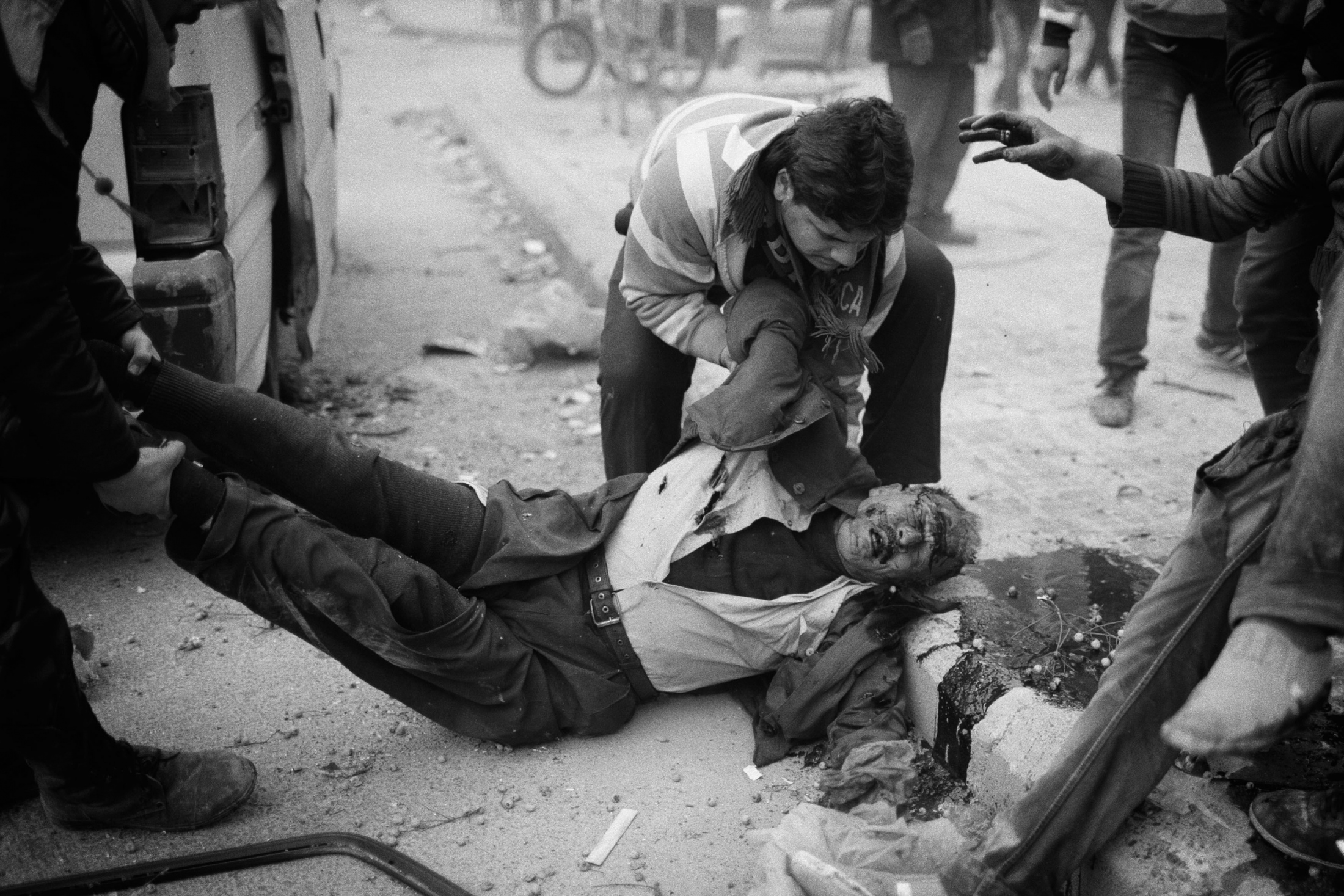 """A civilian lying on the floor after a mortar hits in the street of Izaah neighborhood of Aleppo, Syria, Wednesday, Jan. 13, 2013. The United Nations estimated that more than 400,000 people have been killed in Syria's 60-month-old uprising against authoritarian rule, a toll one-third higher than what anti-regime activists had counted. The U.N. human rights chief called the toll """"truly shocking."""" Copyright: Spanish Photojournalist Andoni Lubaki"""