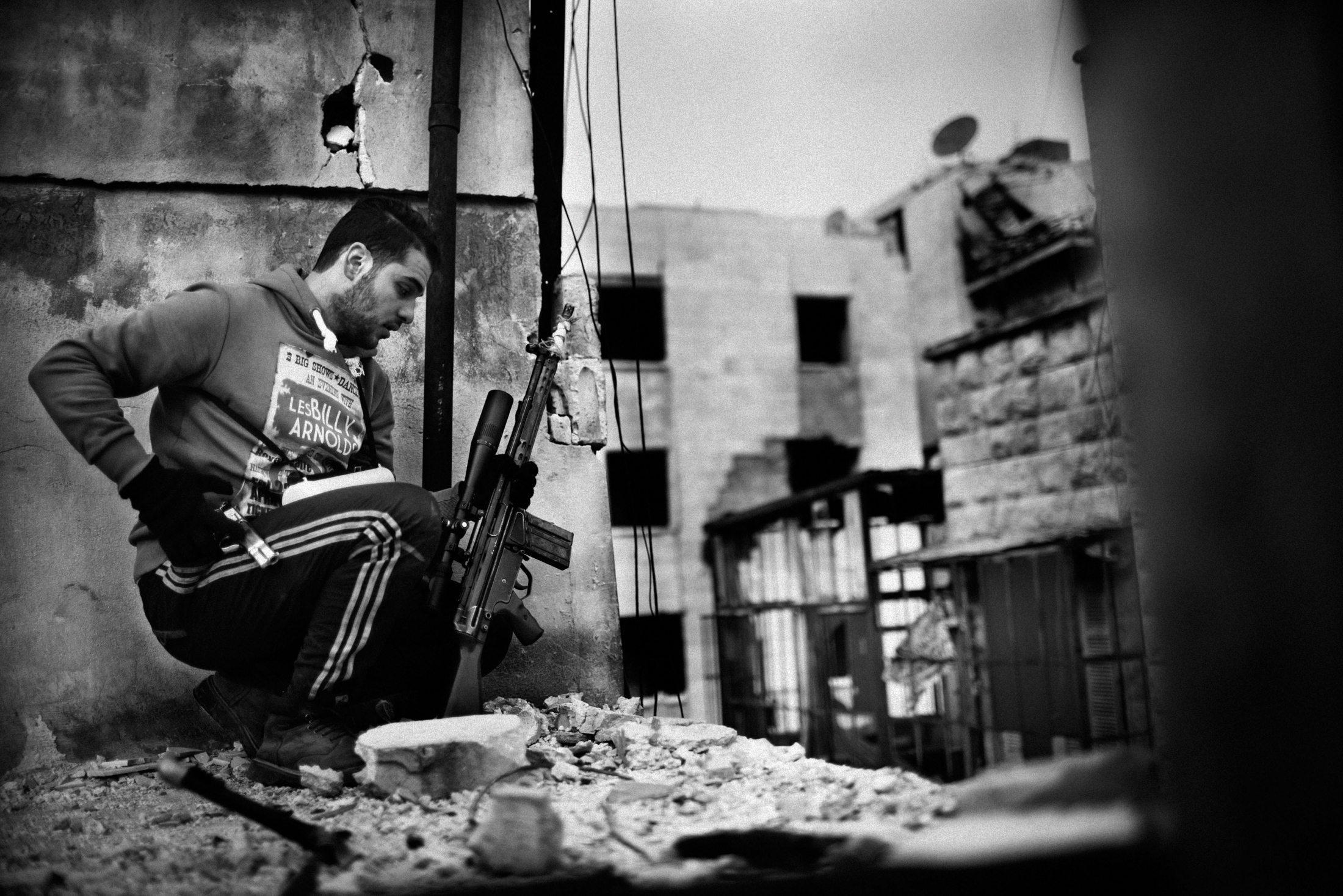 """A Syrian rebel sniper taking position in the frontline of Izaah neighborhood of Aleppo, Syria, Wednesday, Jan. 18, 2013. The United Nations estimated that more than 400,000 people have been killed in Syria's 60-month-old uprising against authoritarian rule, a toll one-third higher than what anti-regime activists had counted. The U.N. human rights chief called the toll """"truly shocking."""" Copyright: Spanish Photojournalist Andoni Lubaki"""