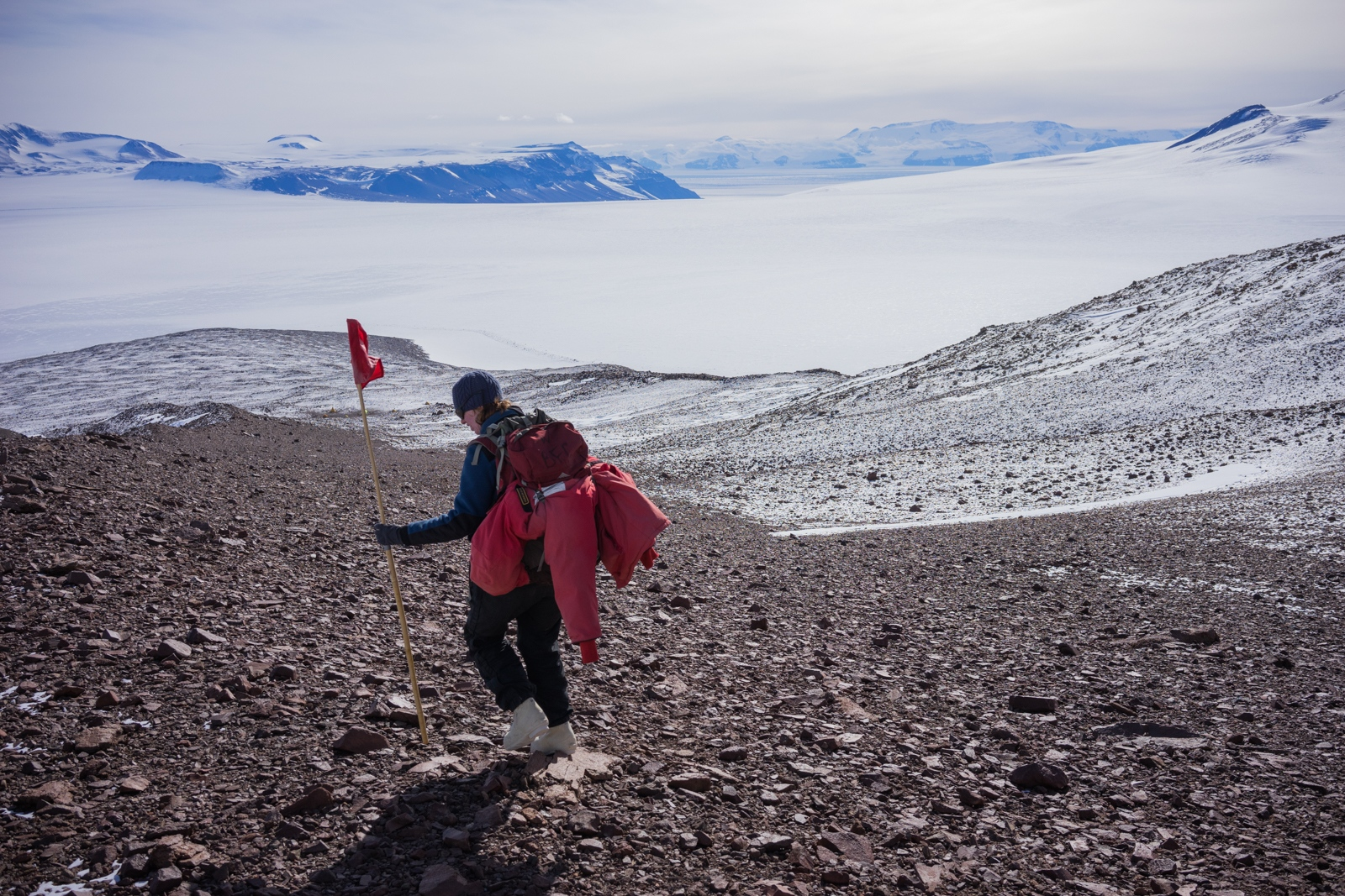 Dr. Patricia Ryberg walking on Graphite Peak (10,700 ft.) after a day collecting plant fossils. 22 December 2017. The expanse of the Transantarctics and the Falkenhof Glacier extends in the distance.