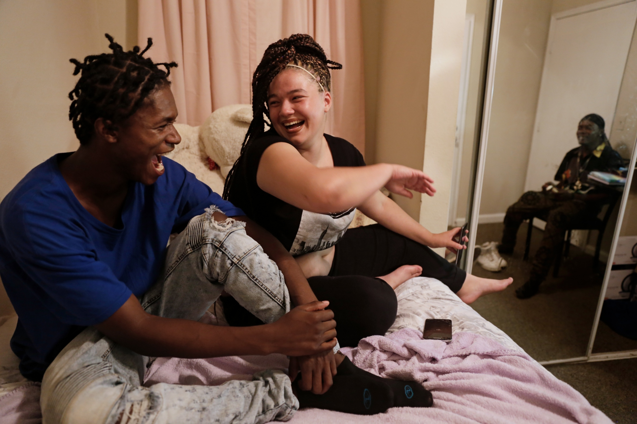 Tyrese Ross, Jasmine Fields and Jamorris Mosely gossip in Jasmine's new room at a student housing complex that a Going Places caseworker helped her procure.