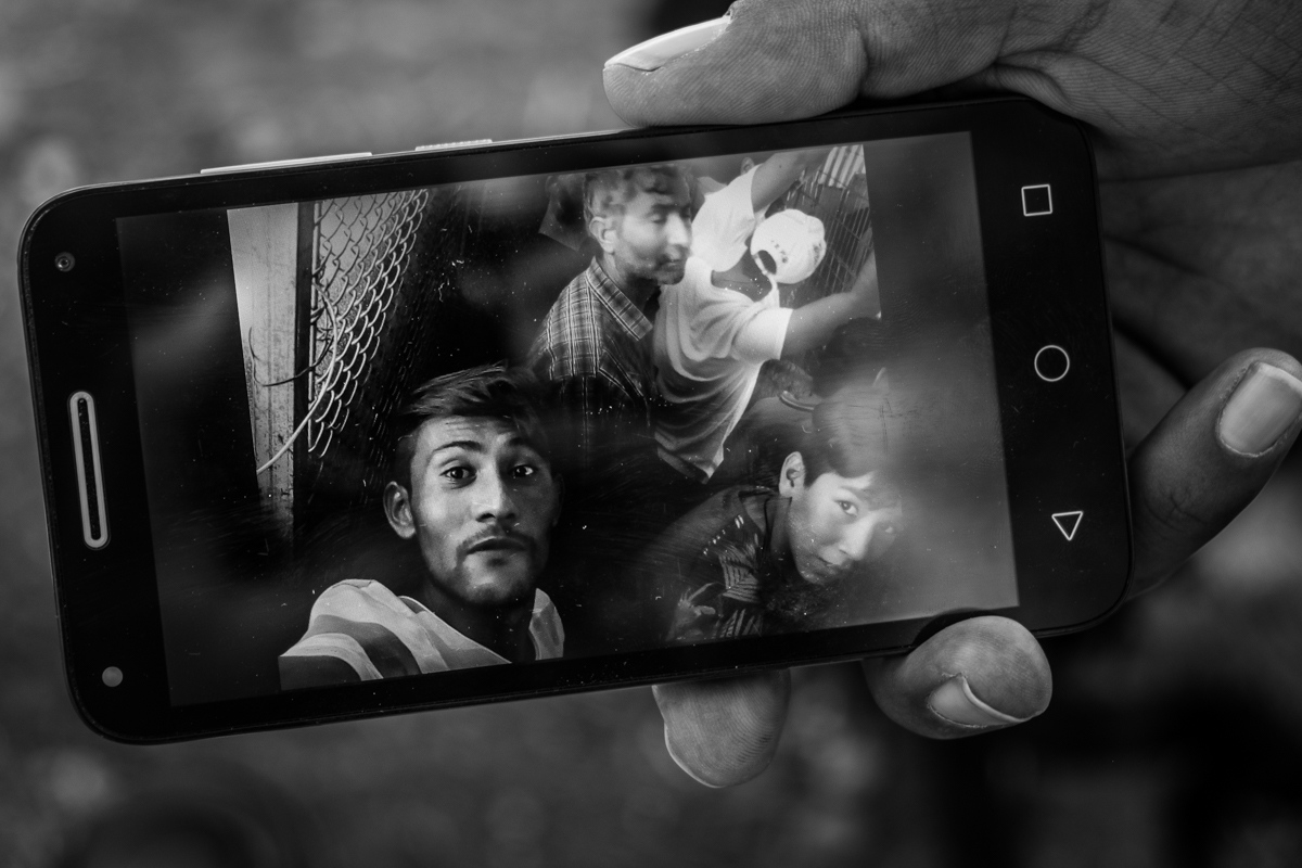 Namatullah shows a selfie he took while waiting in the food line, Moria camp, Lesvos, Greece. People can wait also for ten hours there, and it's a pretty common place for fights as people get exasperated.