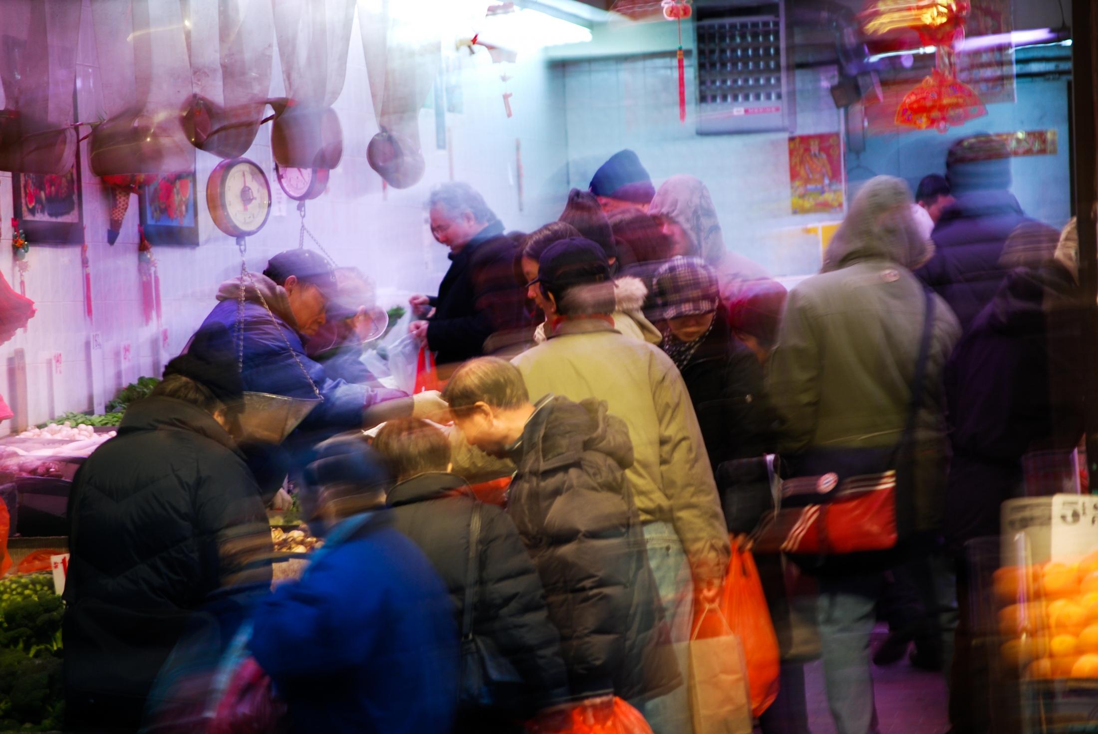 EXT/INT. NEW YORK CITY MARKET (2009) -...