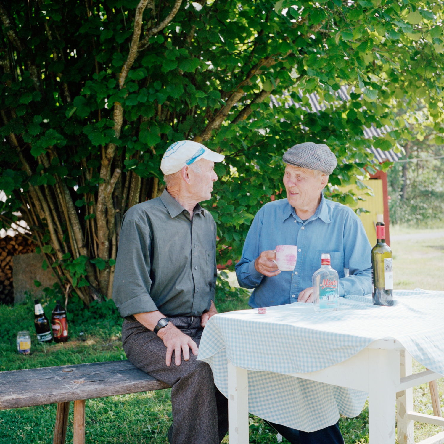 Mihkel Lilles (to the right) is having a chat with his friend Heino. Mihkel went fishing with his father for the first time when he was 6 years old. Today, he is 84 and still prepares his boat, even if he hasn't gone out to sea for the past six years. July 2014.
