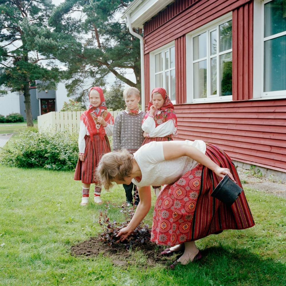 First day of school after summer holidays. The three pupils are going to school for the first time and a plant is planted as a symbol. September 2013.