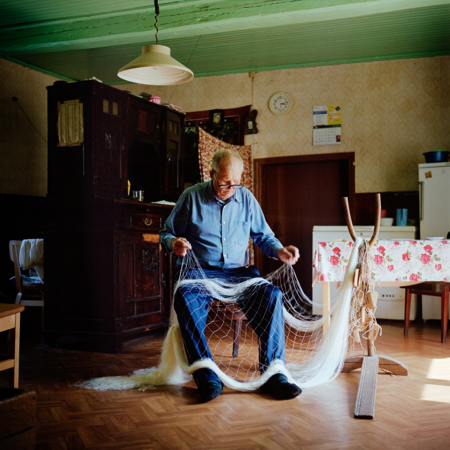 Mihkel Lilles went fishing with his father for the first time when he was 6 years old. Today, he is 84 and still prepares his boat, mends his ofl fishing nets even if he hasn't gone out to sea for the past six years. July 2014.
