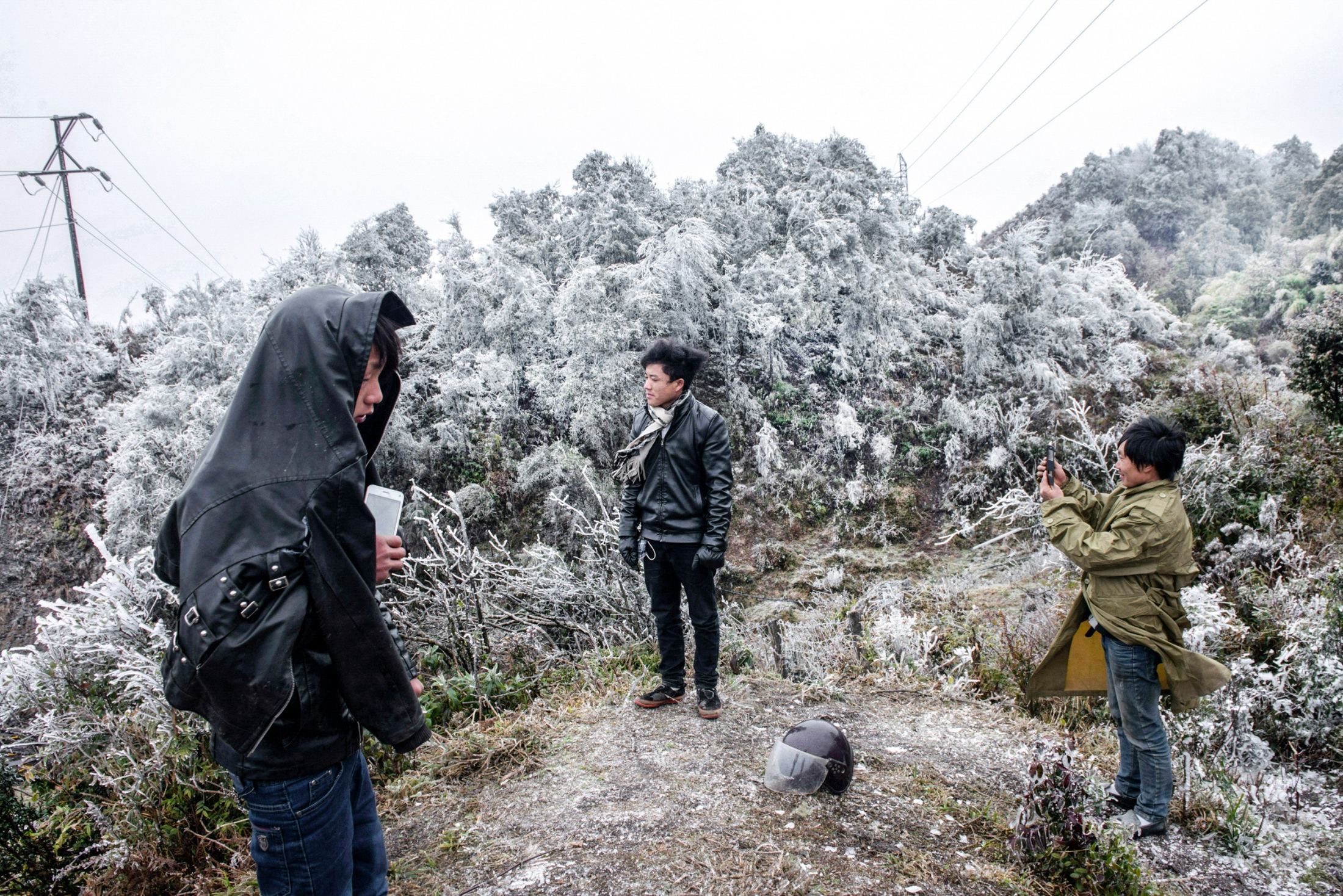 Cold wave causes Zero degrees Celsius on high mountains of Lao Cai province in Northern Vietnam resulted in frost covered their peaks. Locals experience this unusual phenomenon. February 5, 2018.