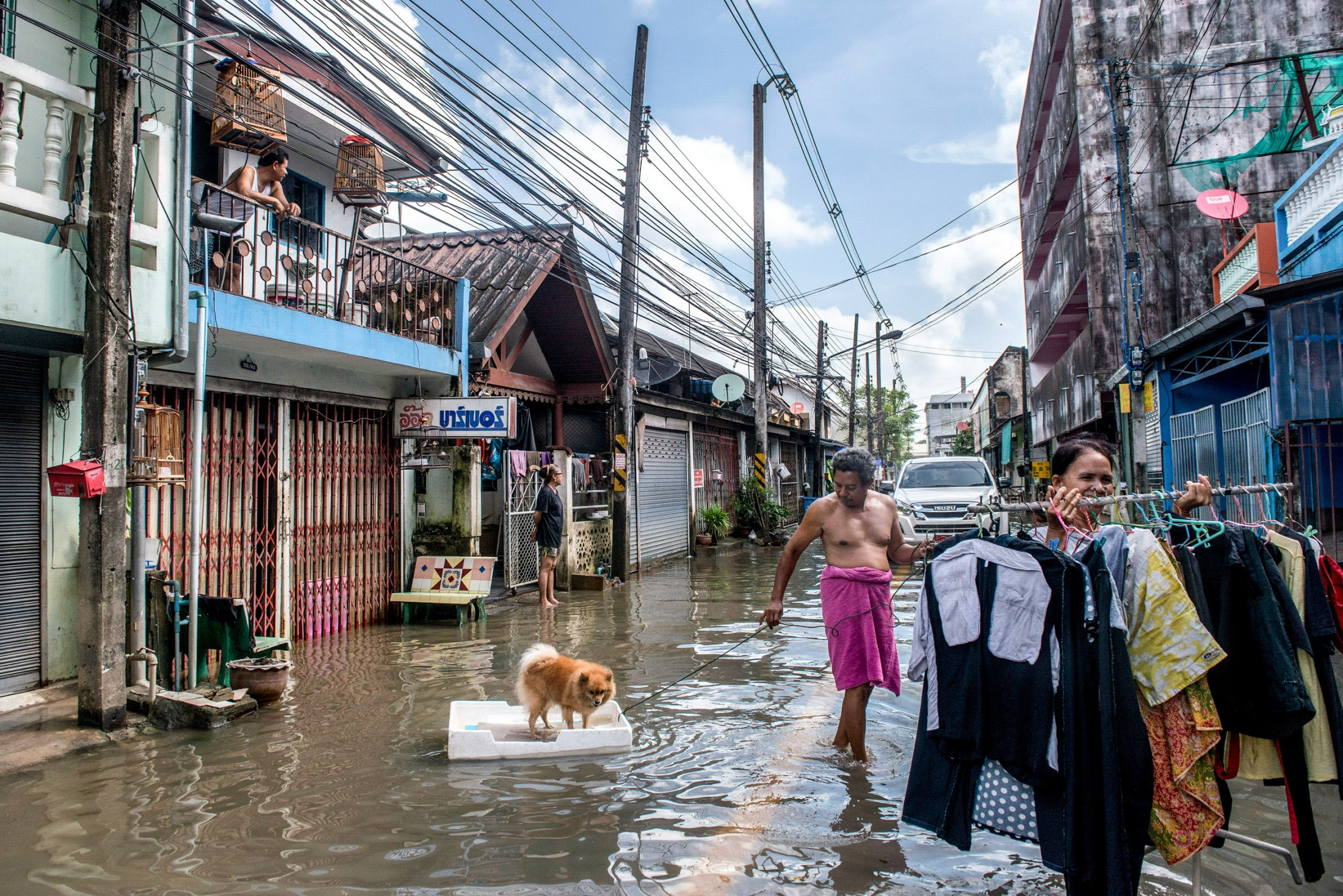 Local villagers are clearing up the mess and create to survey the damages caused from flash flooding resulting from unseasonal, heavy rains three times in one month. Nakhon Ratchasima, Thailand-January 22, 2017.