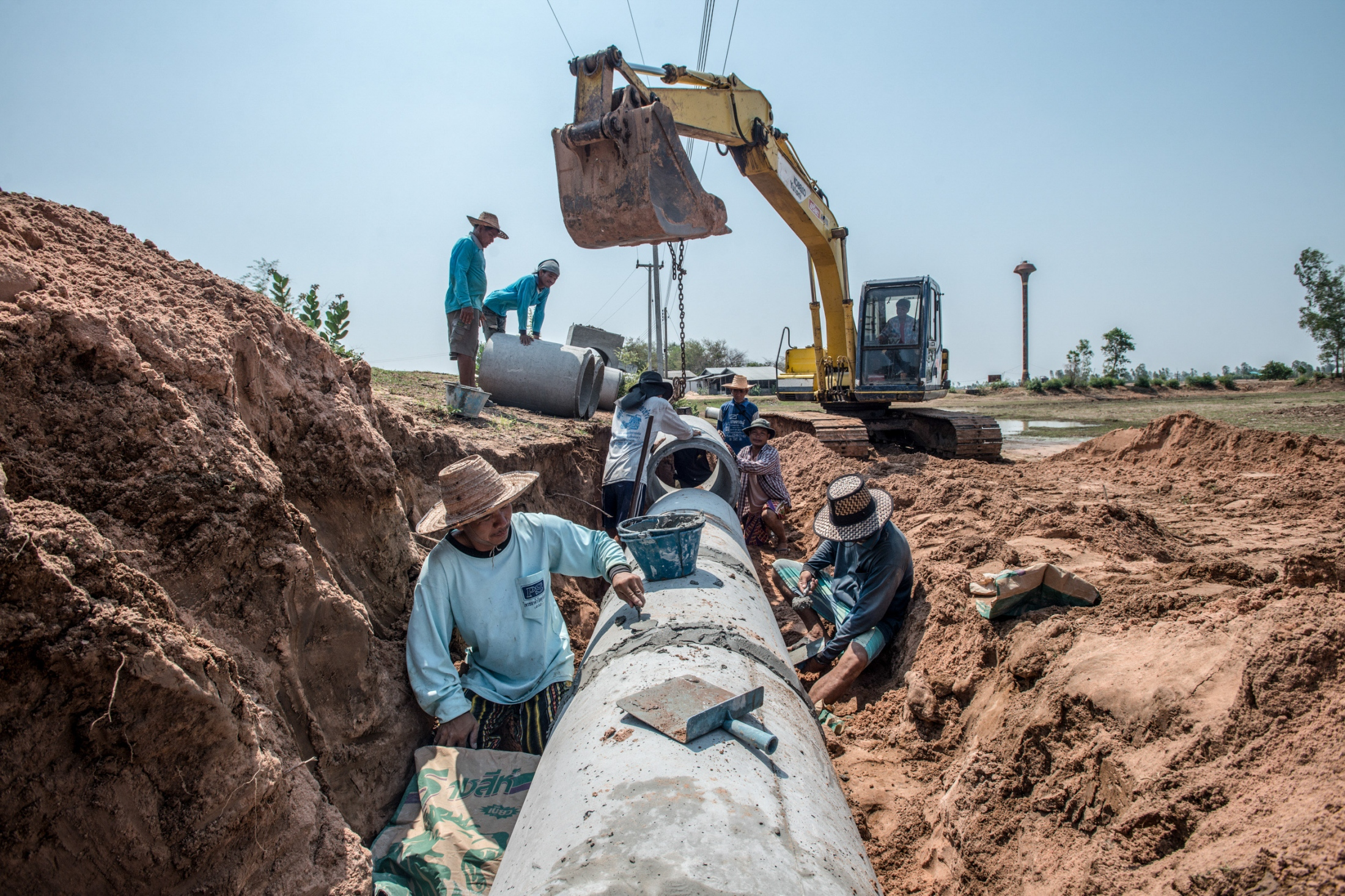 Construction workers are placing water pipe commuting fresh water to villages that have been affected by the extended drought in the heavy drought period.
