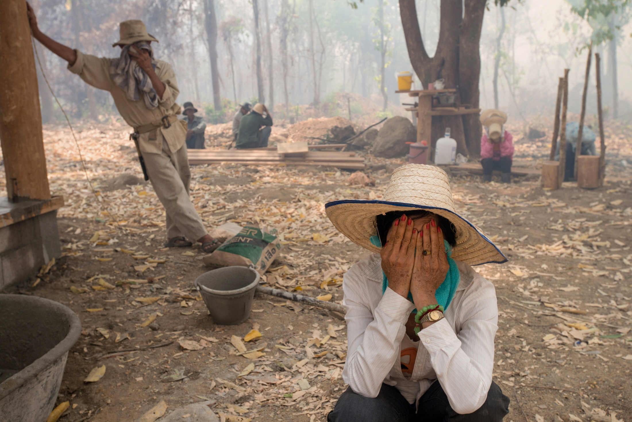 Wildfire occurs during the daytime in a place outside of the city. Widely effects the nearby areas where labors working are covered in haze.