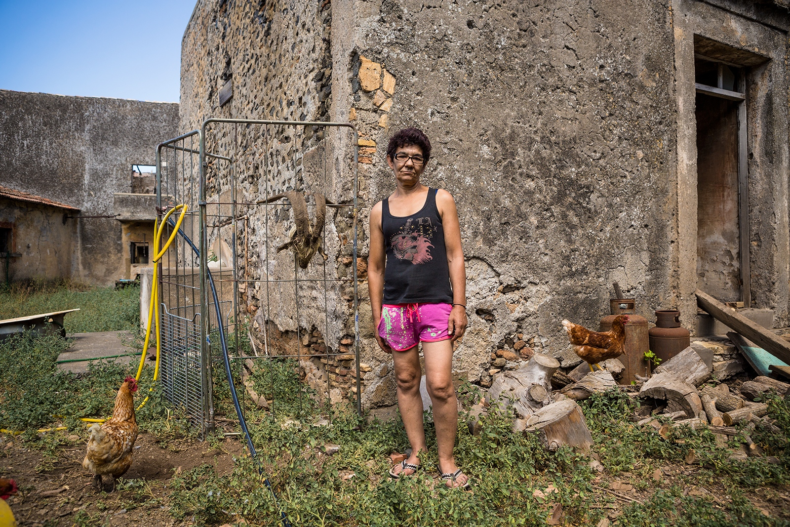 A local Farmer posing next to the remains of a medieval tower erecting in her property