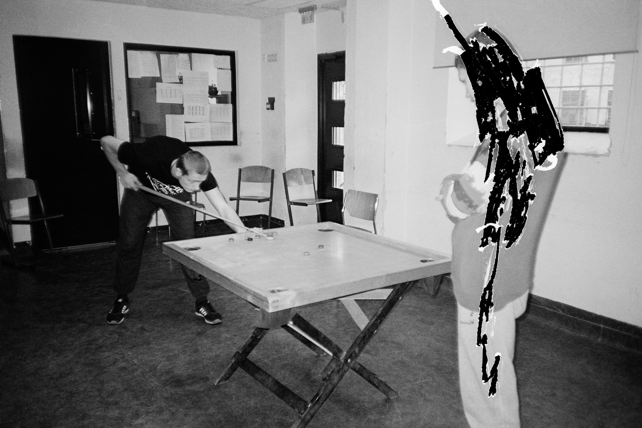 Here the prisoners play a Latvian snooker game called novuss. On the negative, I had to scratch one detainee as he was not participating in the photographic project. (photo: Ivo)