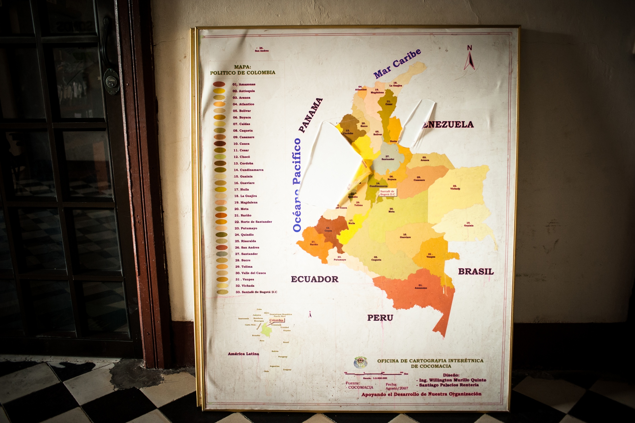 A map in the hallway where Juana works. The area where Chocó should be indicated is torn.