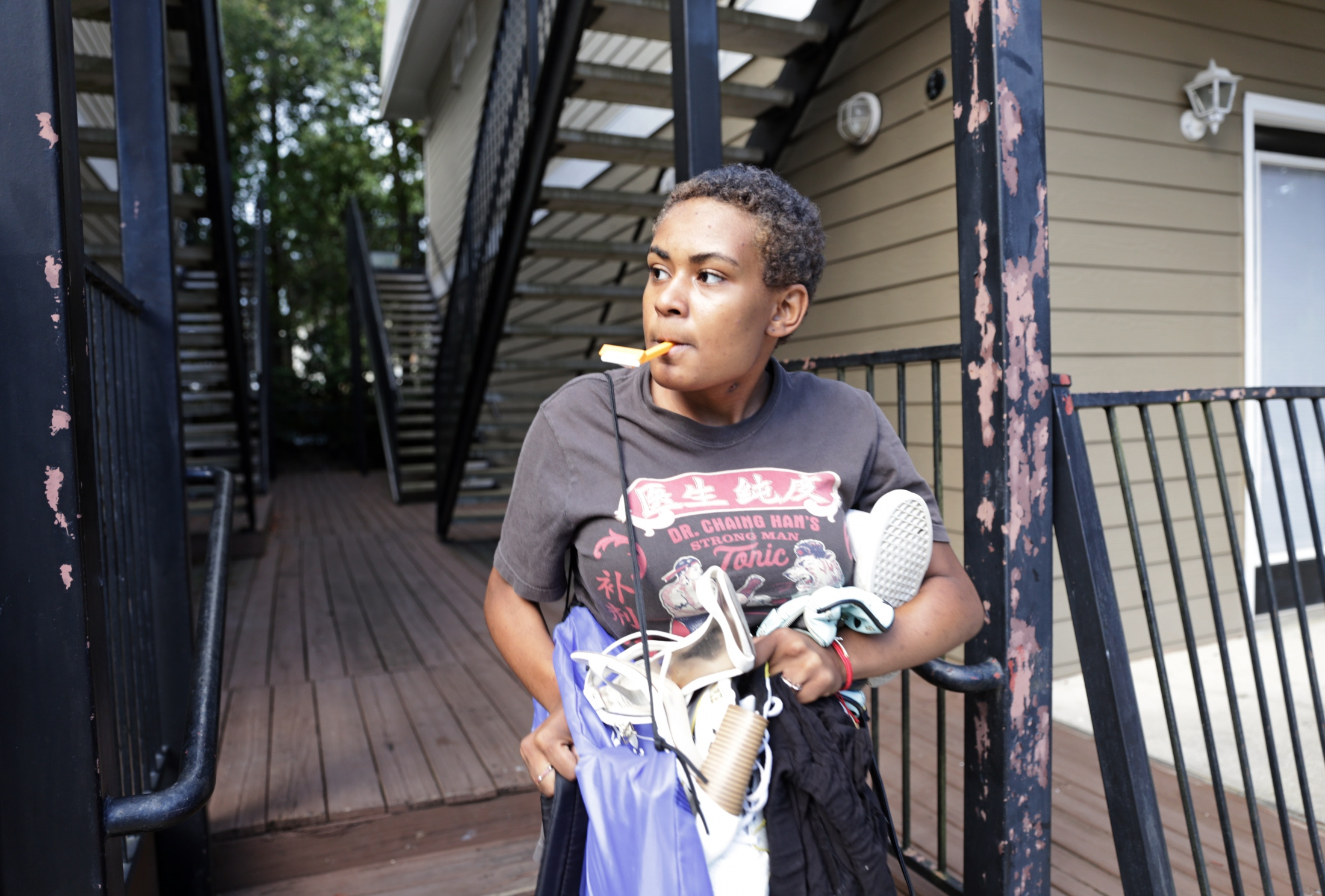 Ravyn Frazier, 15, hustles to move her small bag of personal belongings from a friends house, to, somewhere later. The landlord realized multiple homeless youth were living in the rental and all were evicted. Her mother can't help. She is living on the street as well.