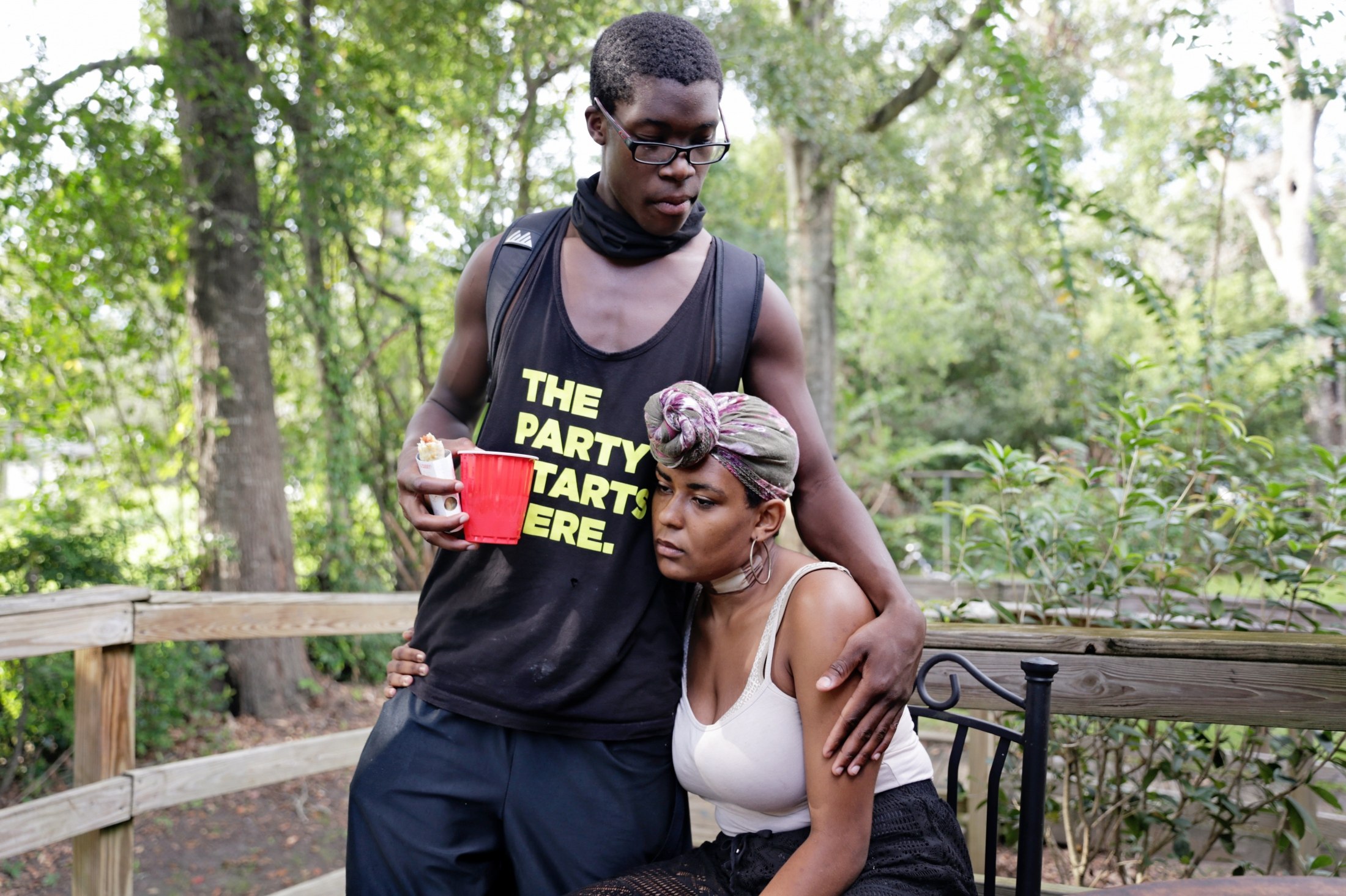 Isaiah Clark comforts Ravyn Frazier on the porch of Going Places.