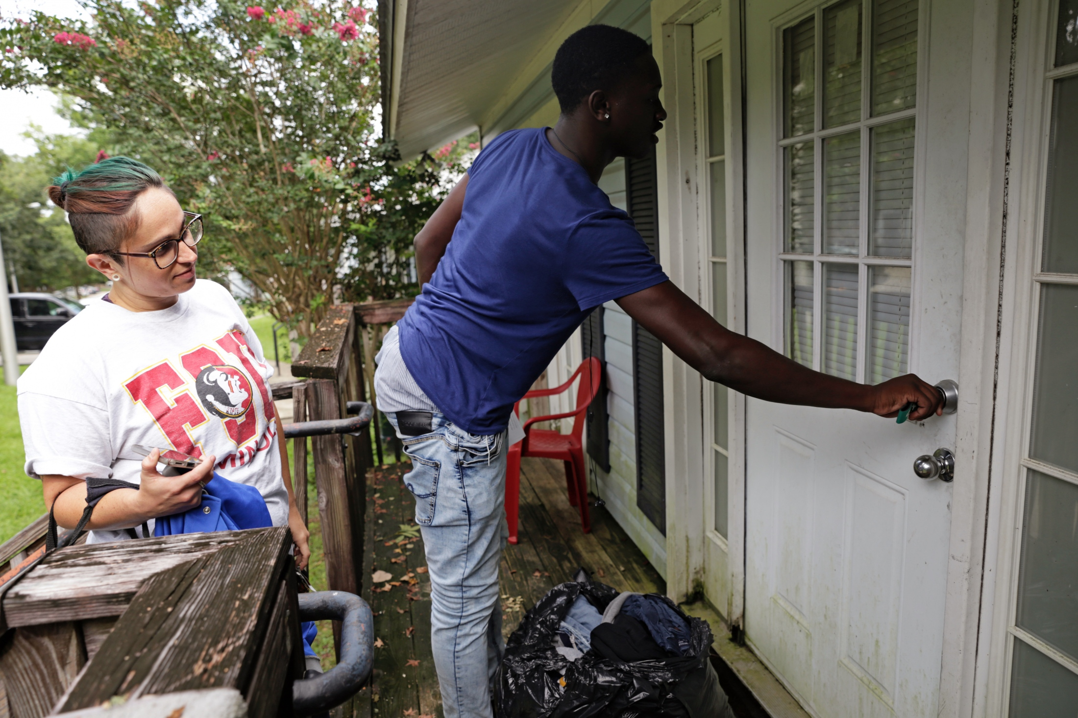 Going Places caseworker Erin Foley helps Ladarius Simmons move into his new room at a student housing complex.