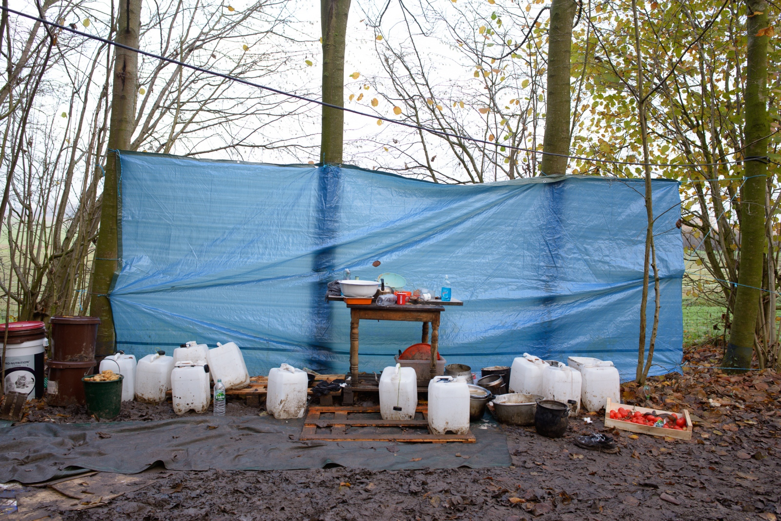 December 4, 2017 - Undisclosed location, North of France. Outdoor kitchen. Local volunteers deliver jerry cans of potable water for cooking, usually once a week. Bottled drinking donated by local supermarkets is also delivered when available.