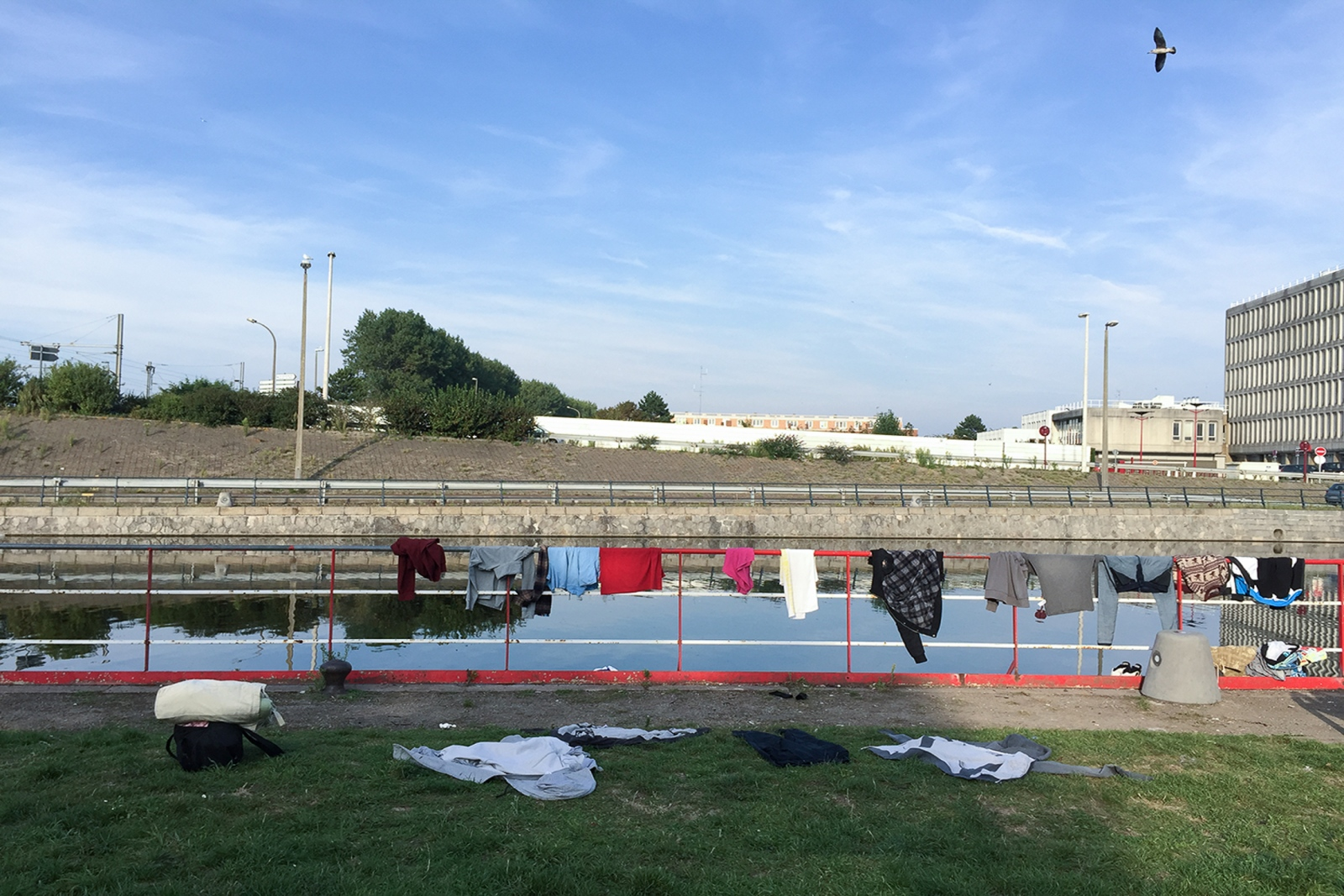 August 28, 2017 - Calais, France. Makeshift laundry. The government has not provided an adequate area where exiled people can properly wash and dry their clothes. Washing of clothes and sleeping bags with clean, hot water is essential for the prevention and cure of skin diseases such as scabies.