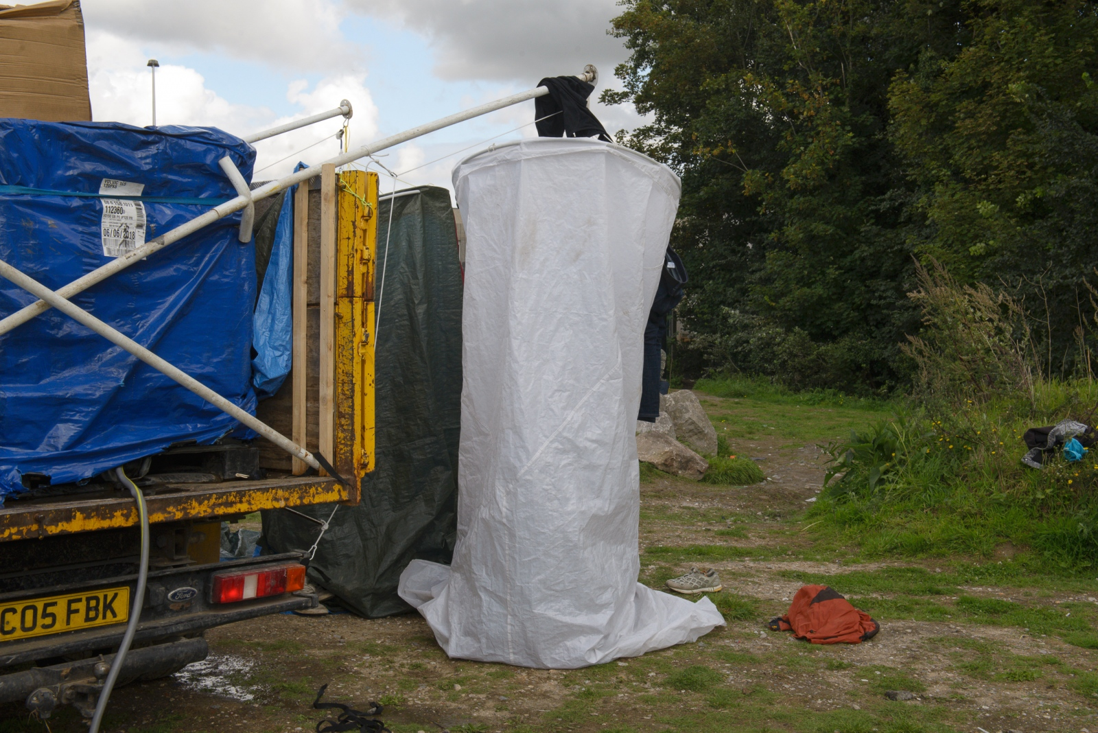 August 31, 2017 - Calais, France.  Local NGOs install six makeshift showers on a water truck. The mayor of Calais, Natacha Bouchard had chosen to pay a fine rather than provide refugees with access to safe water and sanitation. The fine was imposed after the court ruling by the highest administrative court in France that demanded the city of Calais provide certain services to refugees, including access to safe water and sanitation.