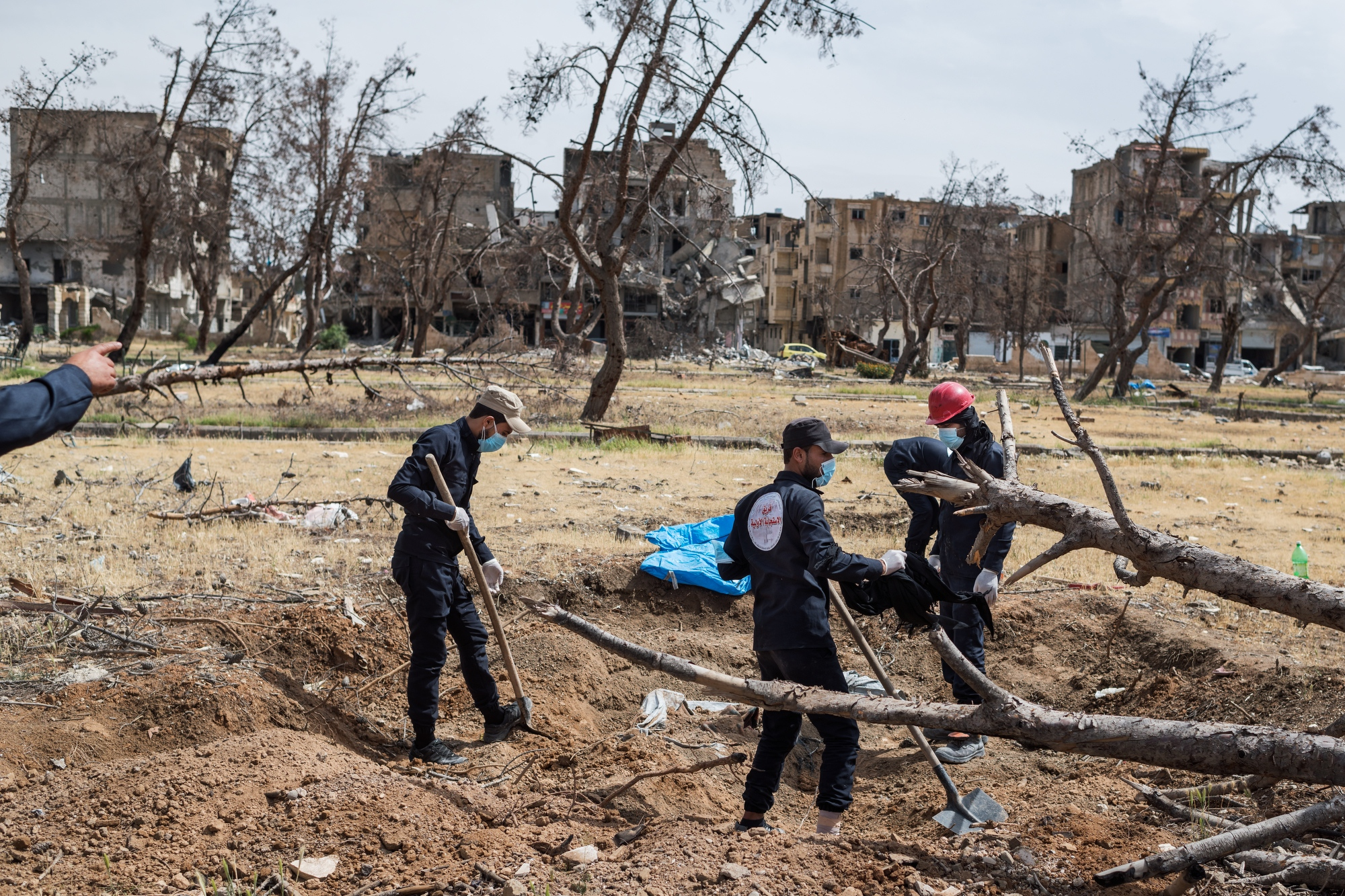 "The first responders team in Raqqa are searching for bodies and human remains in Hediqat Al-beida, ""the white park"" in Raqqa. They say that this particular spot seems to be a mass grave and that they expect to find at least a hundred bodies buried here."