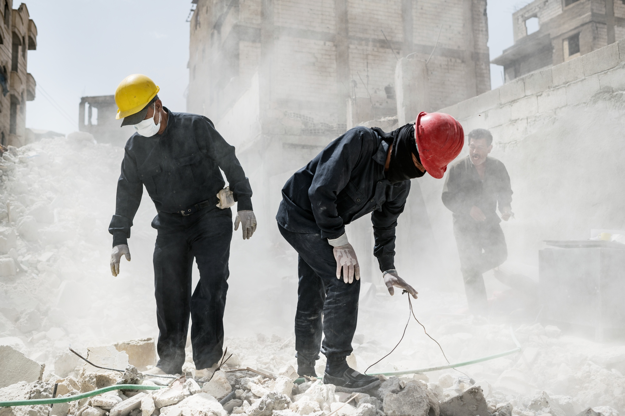 "The first responders team in Raqqa are searching for bodies and human remains in Hay al-Beddo, ""the beduin quarter"" in Raqqa. They have found around 30-40 bodies in this spot. Digging with tractors and heavy machinery and then manually going through the gravel and debris."