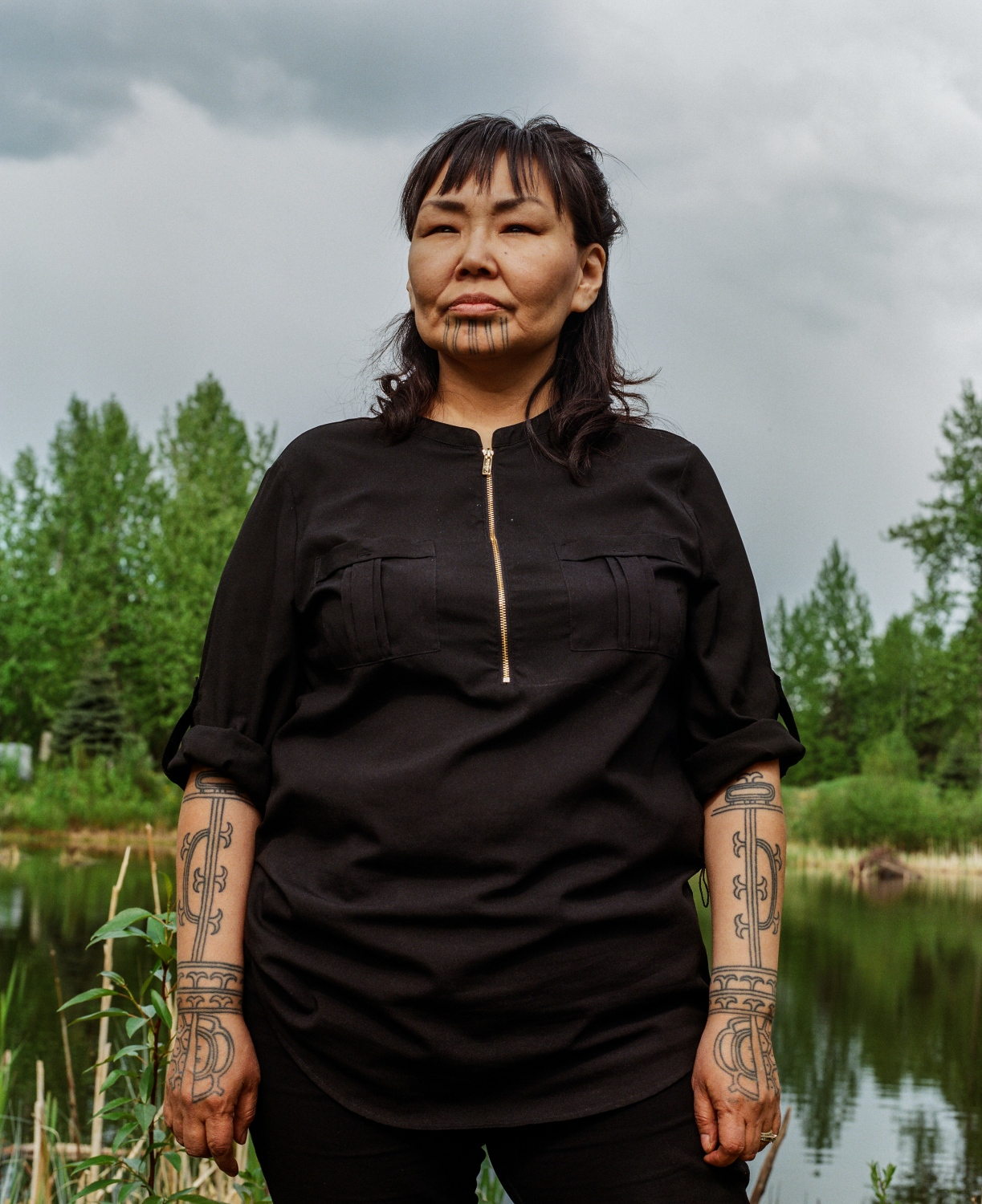 "Several women who have received their traditional tattoos have cited Yaari Walker as a woman who paved the way for them. Walker, originally from Savoonga on Saint Lawrence Island, had her chin tattooed at a tattoo parlor in Anchorage over 10 years ago. ""My mother's mother had both cheeks, her chin—she also had 11 stripes, that's why I chose to do 11, because of my grandma. She had two lines going down her nose and her hands and her arms. So, I knew that eventually that I wanted to do tattoos,"" Walker says.  When women praise her for having paved the way for them, she says it just makes her think of her ancestors. ""I think about the ancestors. This idea came from them. It was their invention. It wasn't me. This tradition didn't come from me. So the ancestors are who I think about when people say that,"" she says. But she recognizes that now this movement has an evolved significance as a revitalization. ""This is a part of decolonization. This generation is the one putting its foot down and saying hey, we want our traditions back. What was once shamed is now coming back to life very beautifully and very strong."""
