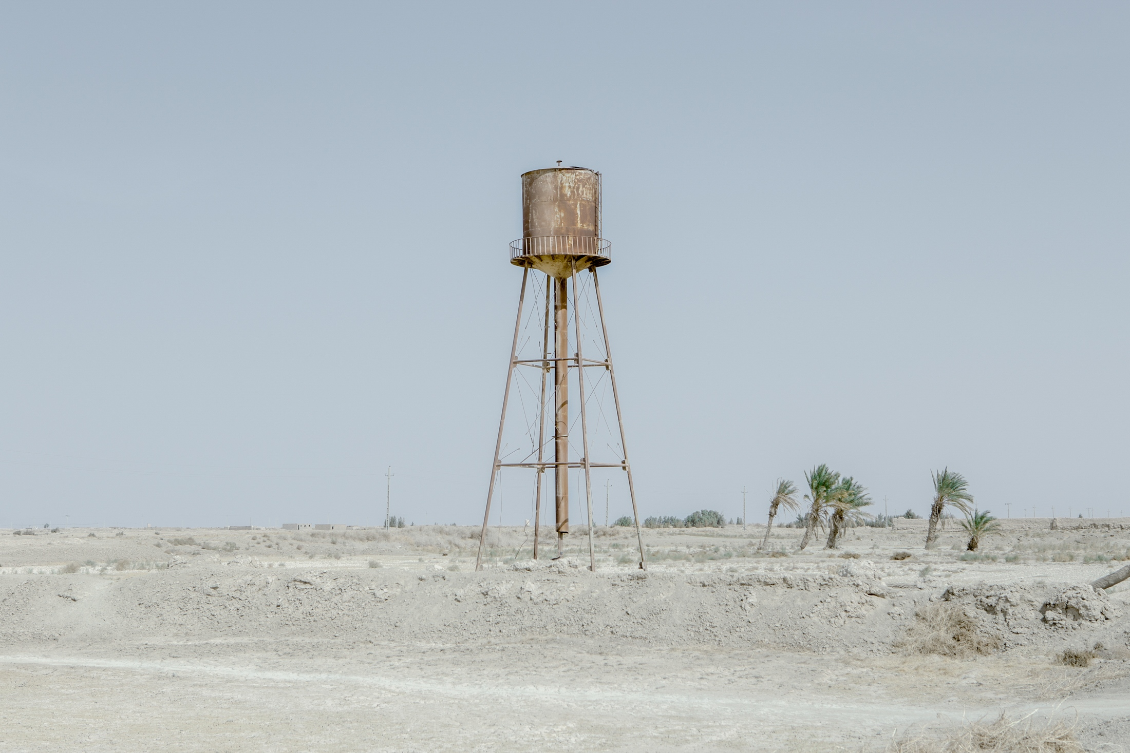 More than 2000 villages are supplied water with tankers and many of them do not have healthy drinking water. The worn, empty and old water tank in the borderline village of Bari-E Mir Ghul. High population, more rural population than urban population, the persistence of droughts,  scarcity of water resources, deficient rainfall and historical backlog in water supply infrastructure are characteristic features of Sistan and Baluchestan province. After the Hirmand River was dried up, the people of the area lost their farming, and the farmland has now become dry, waterless and grassland. Also, with the drying up of the Hamun fishery in the area, which was one of the indigenous occupations in the area, the boats left in this dry wetland show an unfortunate and critical situation in the area. Sistan and Baluchestan province. Iran.2018
