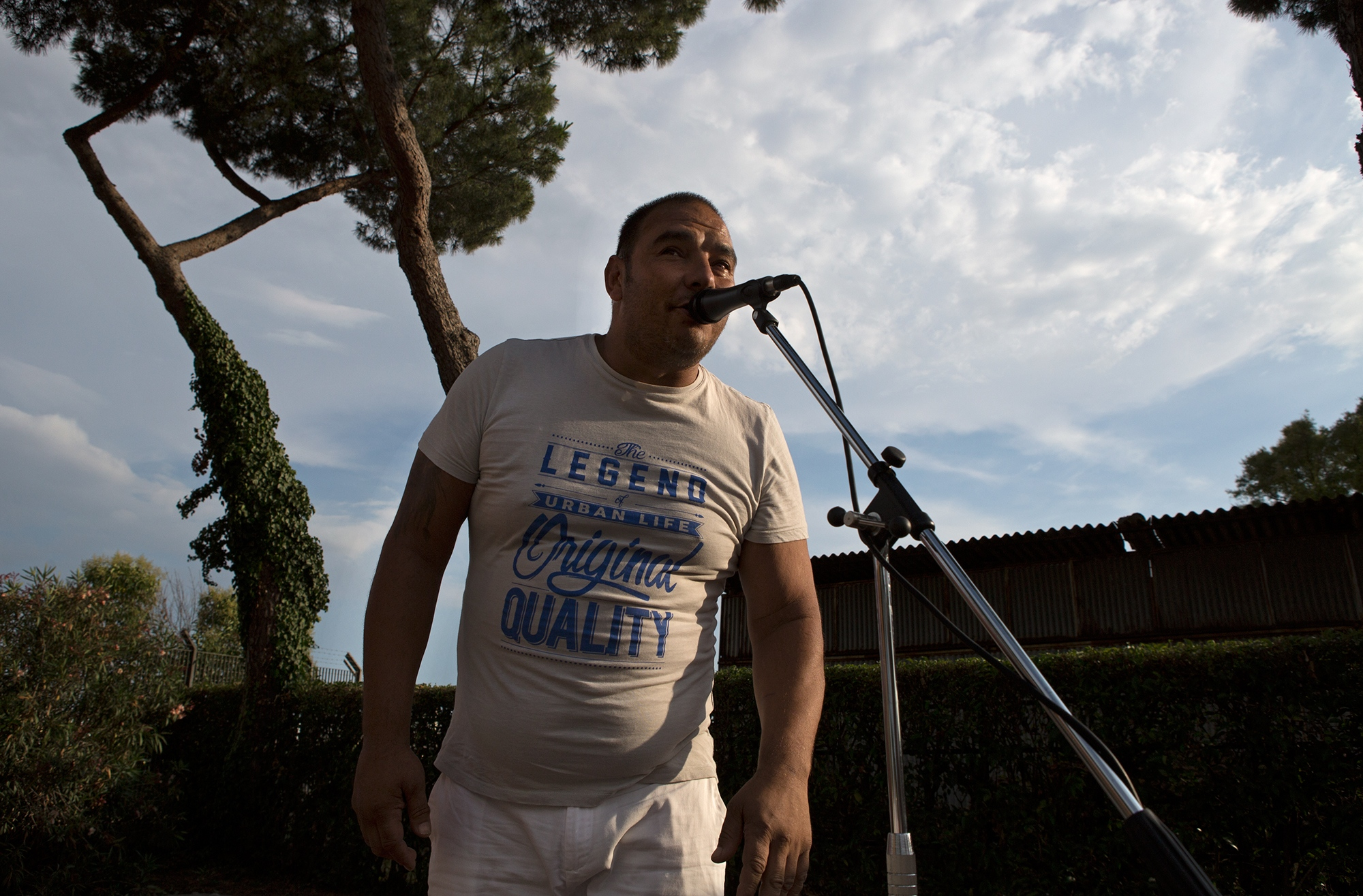 A man of Sinti origin singing at a karaoke during the annual celebration of the patron saint day
