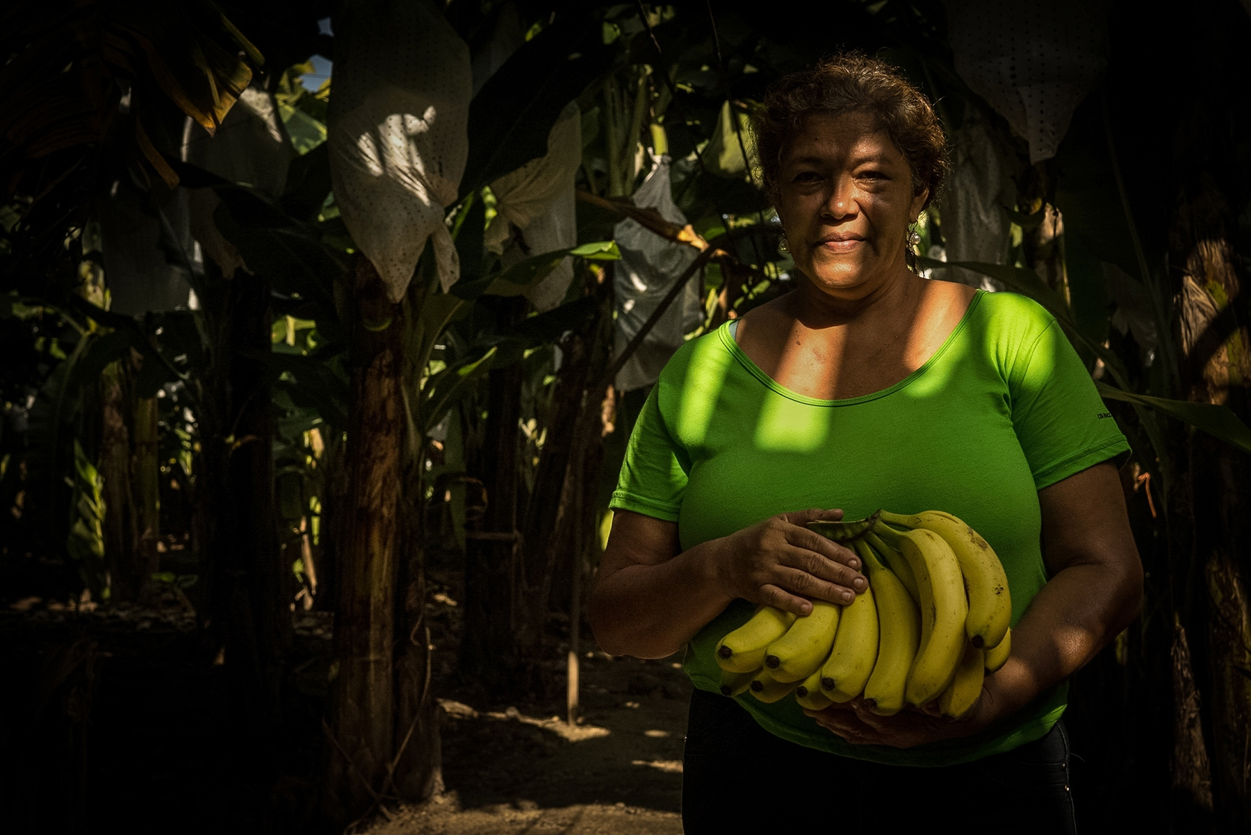 A portrait of Norma Gómez, 52, inside a Chiquita International banana field in La Lima, Honduras. Last February, workers of Chiquita went on strike to demand a medical clinic near their workplace. To this day, their request remains unanswered. With high production rates and little attention to conditions in the field, Chiquita, one of the biggest fruit companies to operate in Honduras and the leading distributor of bananas in the United States, exploits its workers.