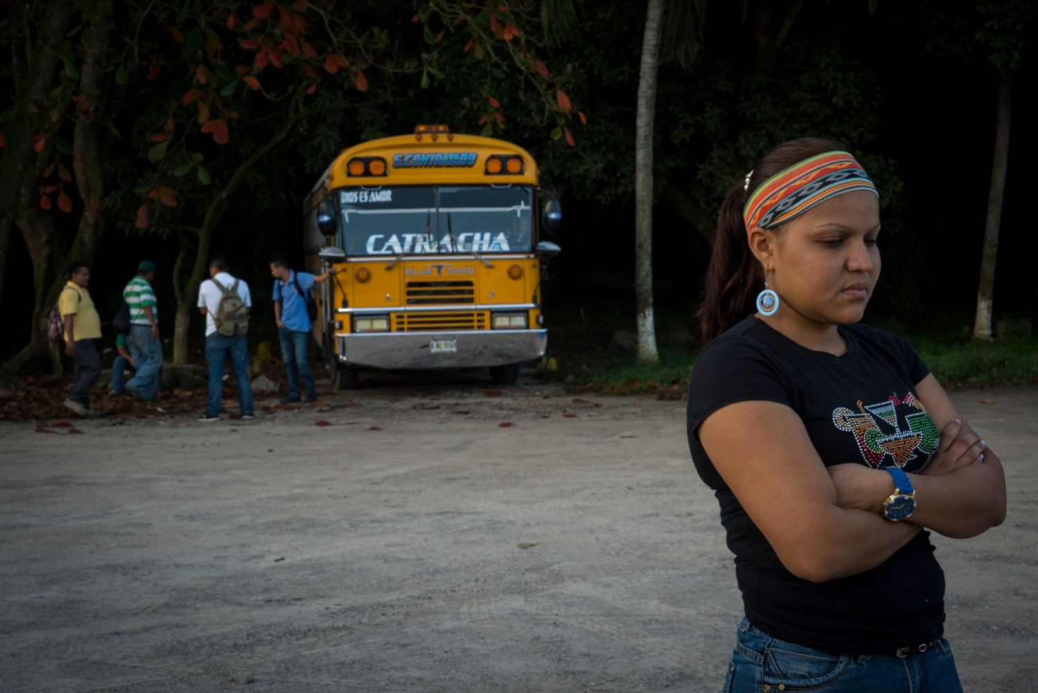 "Roxana López, 27, one of Gómez's youngest coworkers, stands in front of the company's bus drivers. ""There used to be a motto in the company that went, 'First the workers, then the work,"" López said. ""Now, it's the other way around."" The workers were on strike for 75 days, during which they received no salary and relied on family and community members for food and basic living expenses."