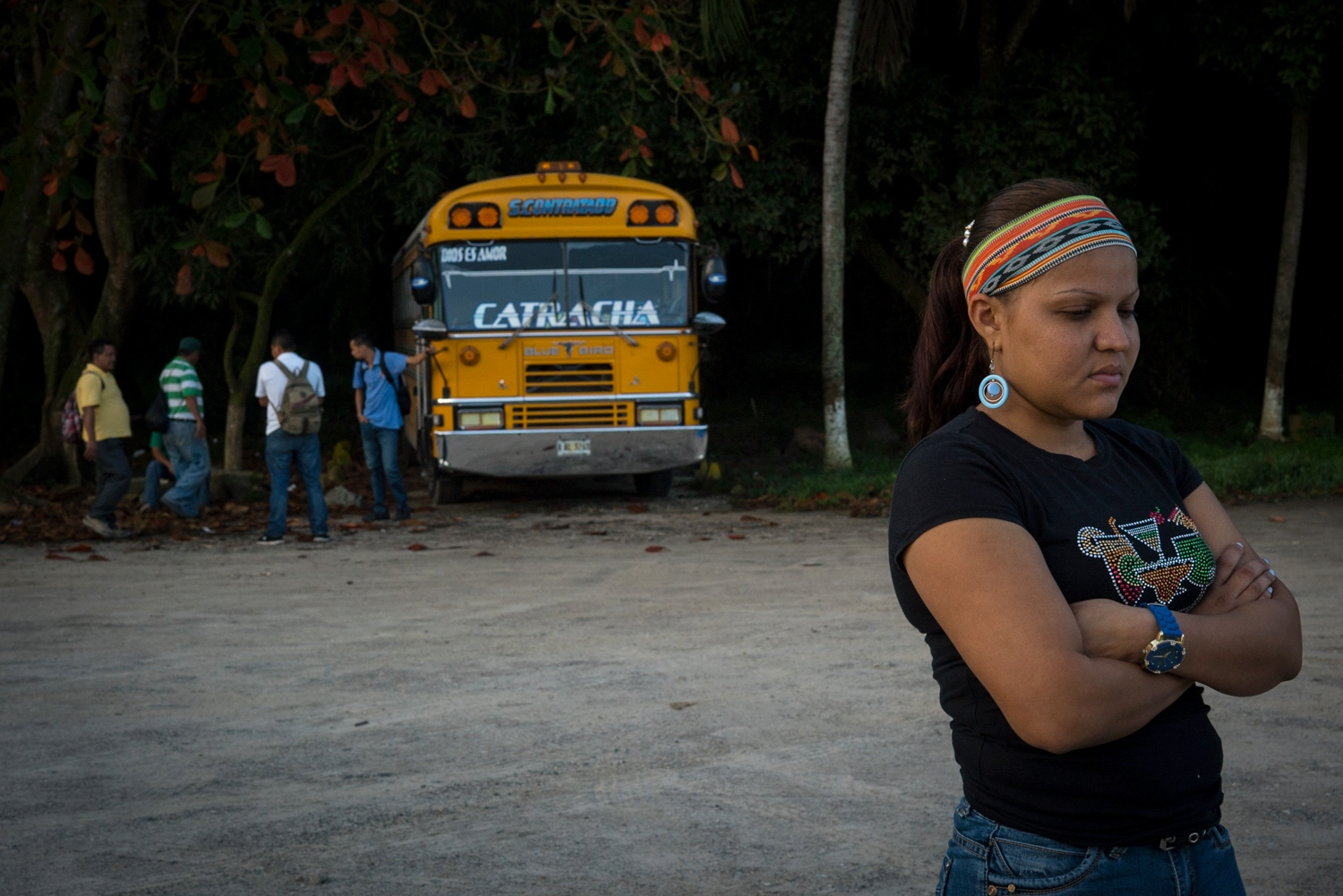 """Roxana López, 27, one of Gómez's youngest coworkers, stands in front of the company's bus drivers. """"There used to be a motto in the company that went, 'First the workers, then the work,"""" López said. """"Now, it's the other way around."""" The workers were on strike for 75 days, during which they received no salary and relied on family and community members for food and basic living expenses."""