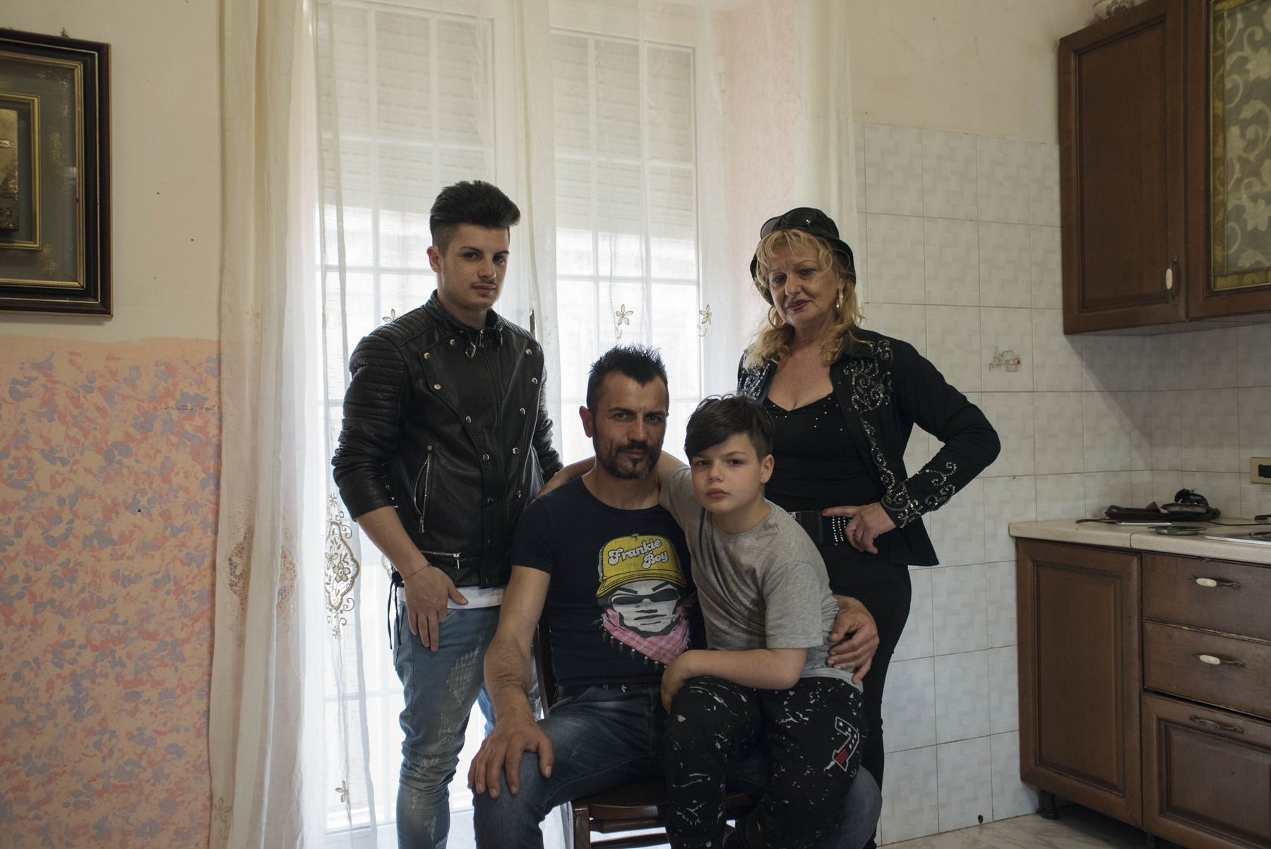 The Doria family poses at their home. From the left, Ivan Doria, 19, Gianni Doria, 42, Eman Doria, 9, and Maria Doria, mother of Gianni and singer as well.