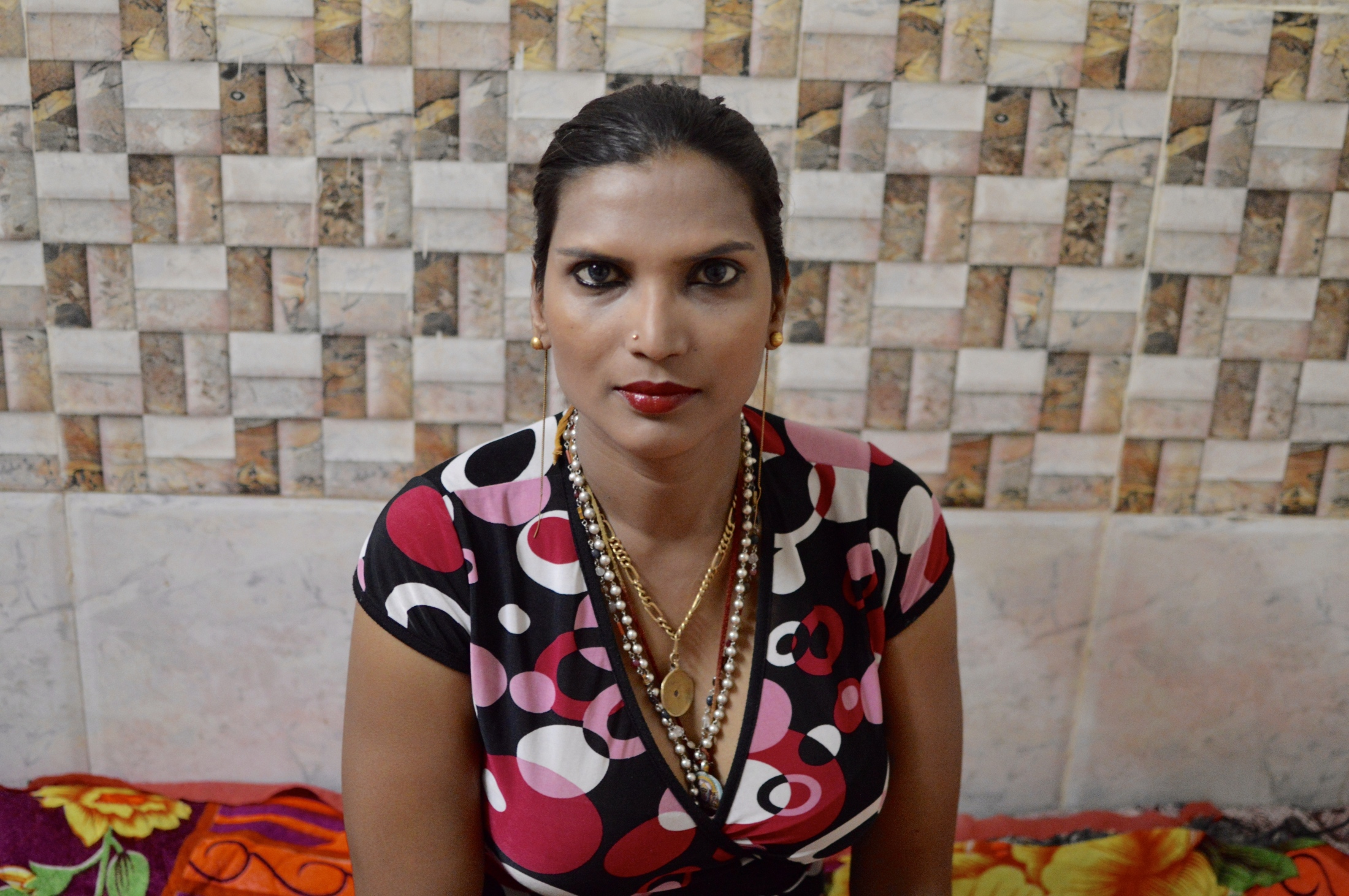Transgender woman Malaika Desingh poses after making her make-up in her house in Chennai, April 2017