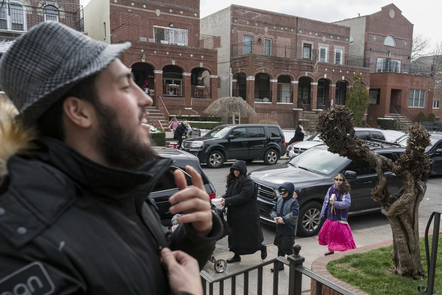 Mendel greets his next door neighbours in Crown Heights, Brooklyn during Purim. He and his siblings grew up in the same house until he left to study Torah at the Midtown Manhattan Chabad center.