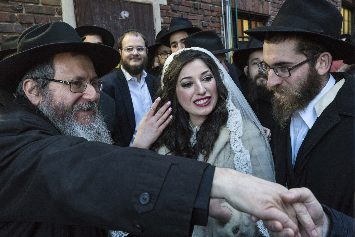 Chanale Gourarie (middle) and Zalman Rachik (right) greet relatives after being married under the Huppah at 770 Eastern Parkway, the Chabad Lubavitch headquarters in Crown Heights, Brooklyn. Zalman 22 and Chanale 20, met through mutual acquantinces in the Chabad Lubavitch community.