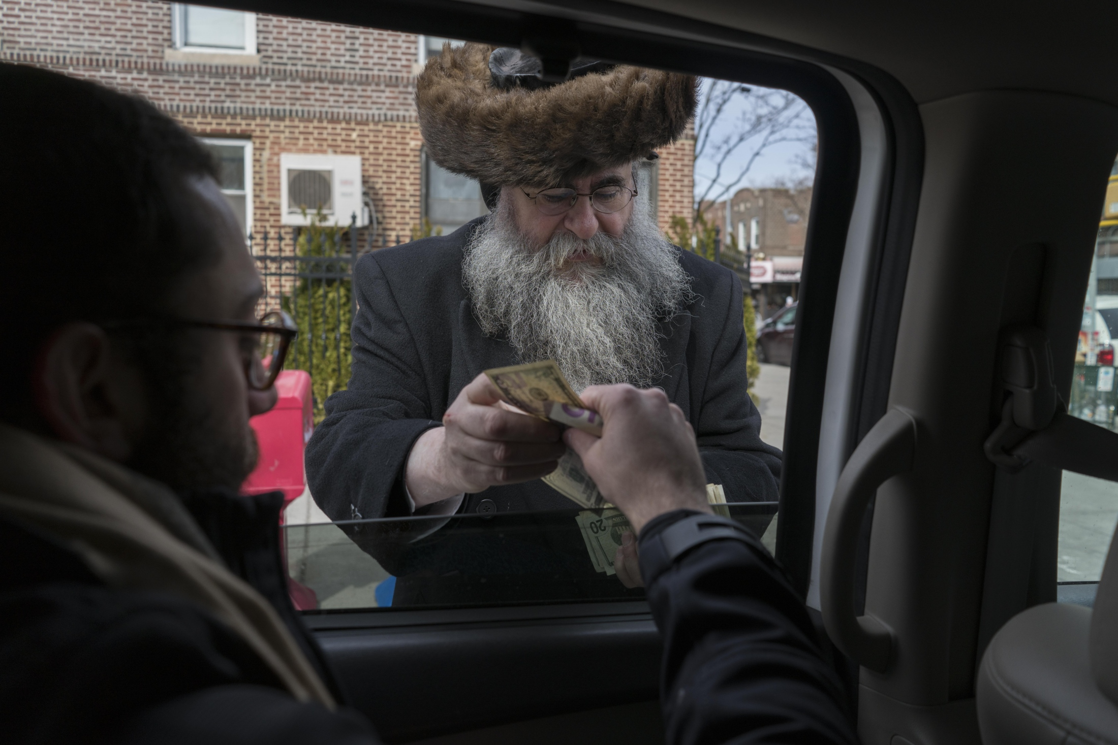 Lubavitchers give money to strangers as a Mitzvah on Purim.