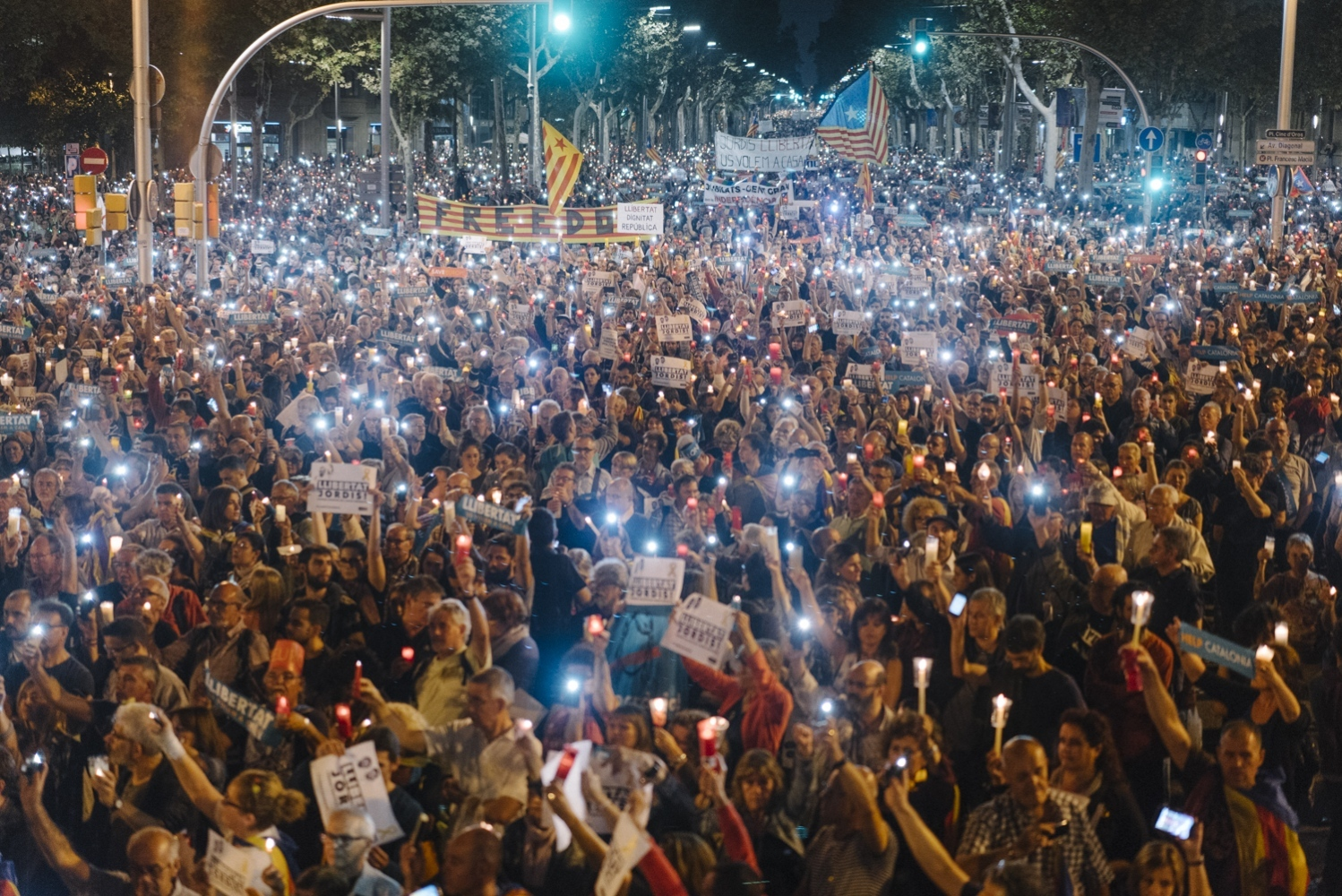 A massive crowd of over 200,000 people in Barcelona raise candles and phones during a 5 minute silence for Jordi&Jordi, the leaders of the largest civil societies in Catalunya who were imprisoned by a Spanish judge, October 17th, 2017. The leaders face charges of possible sedition for organizing protests in response to September 20th when the Spanish Guardia Civil arrested Catalan officials in various government offices in an attempt to foil the October 1st referendum.
