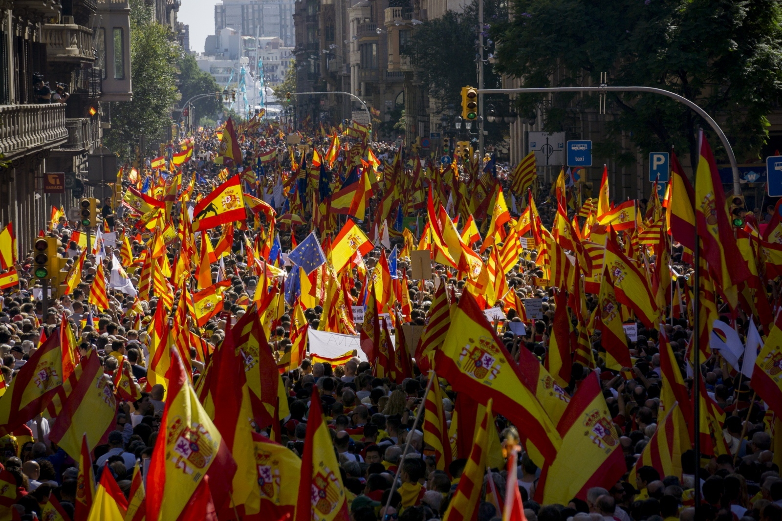 Hundreds of thousands of protesters fill Barcelona's Via Laietana, Oct. 8, 2017. Organized by the Societat Civil Catalana, the march drew 350,000 atendees according to the Guardia Urbana and just under 1 million according to the organizers.