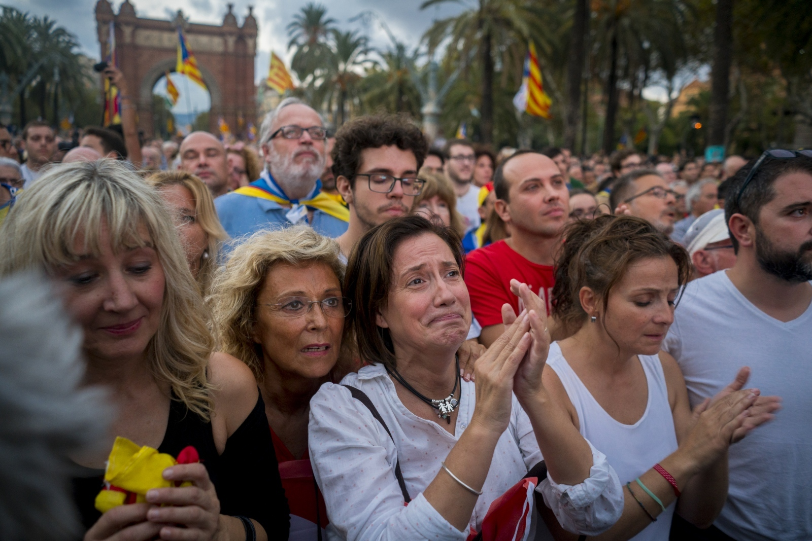 Muntsa Casas watches Catalan President Puigdemont's speech on a mega-screen in Barcelona on October 10th, 2017. After declaring independence, the President invoked a pause for dialog before Catalonia begins a formal process towards becoming an independent state.