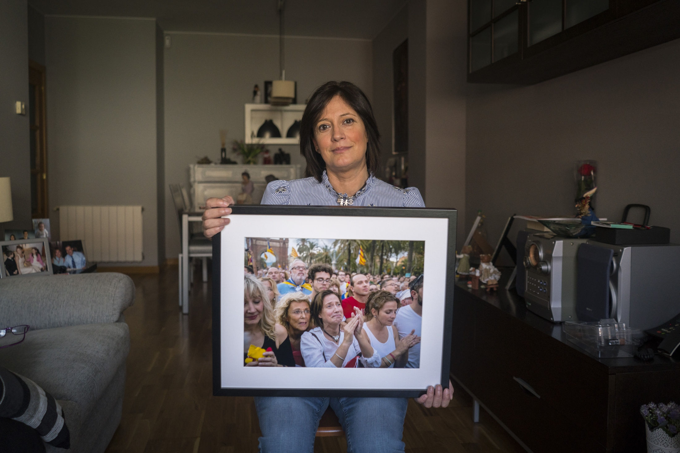 When presented to her, the photograph triggers an emotional response as Muntsa recalls her continued support for the movement since she was young. Muntsa is deeply committed to the Catalan independence movement and has an overwhelming hope for its future.