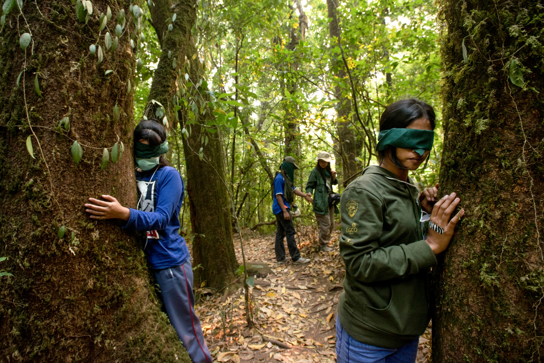 Young people use sensory activities to awaken their own sense of connection with nature. They have been implanted with the sustainable values of environmental savings by a group of environmental activists. March 24, 2014.
